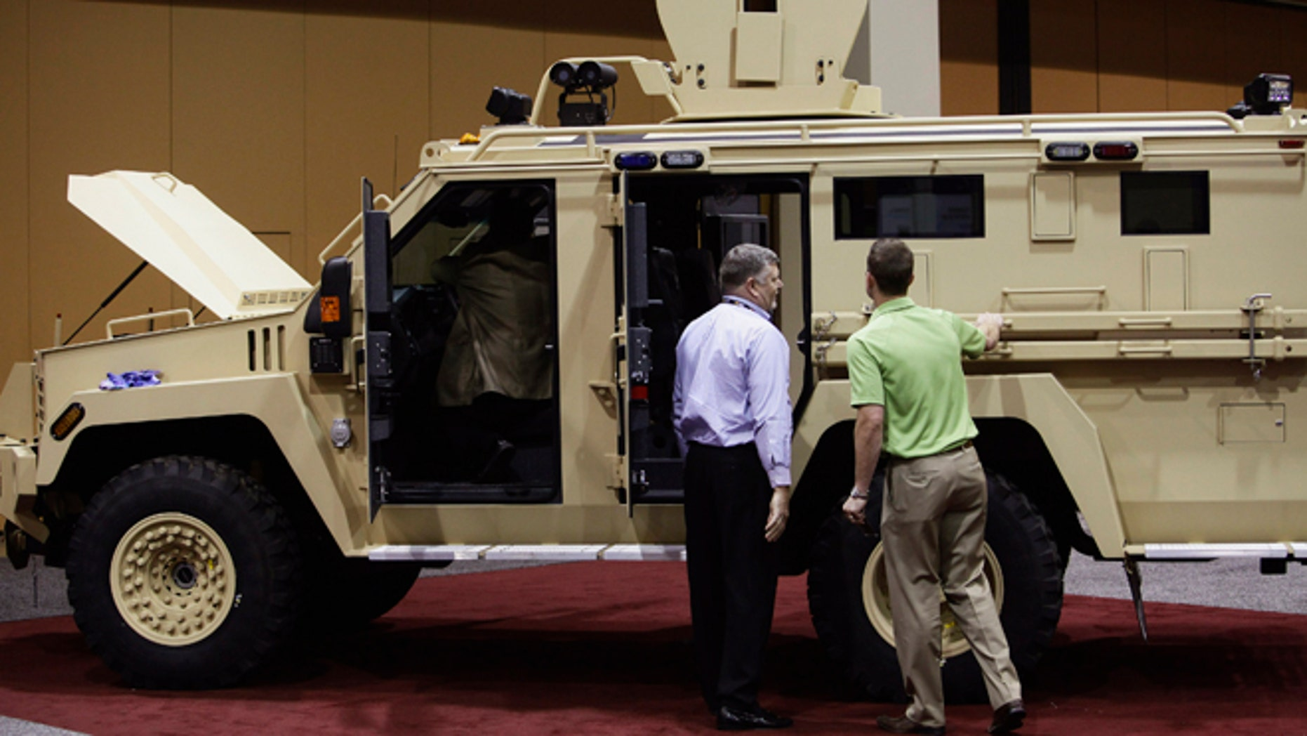 March 12: Attendees look at the Lenco MRAP Bear SWAT Team vehicle at the 7th annual Border Security Expo in Phoenix, Arizona.
