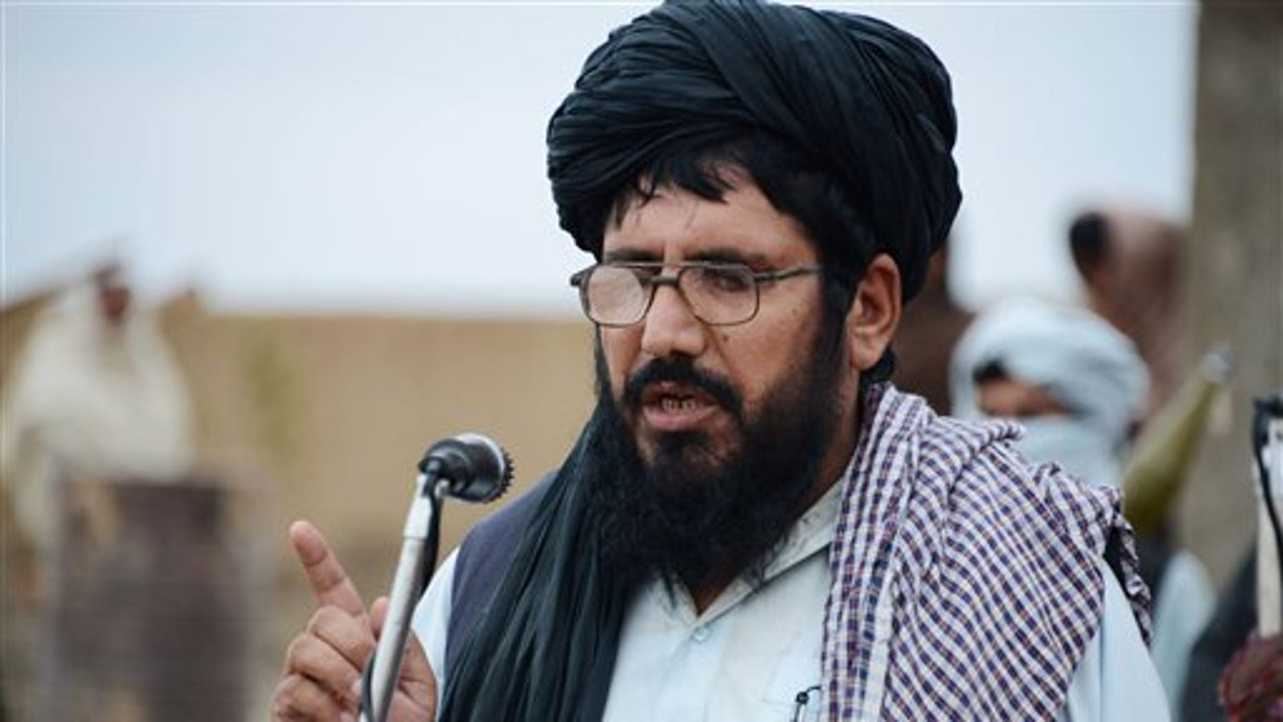 In this Tuesday, Nov. 3, 2015 photo,  Mullah Mohammed Rasool, the newly-elected leader of a breakaway faction of the Taliban speaks during a gathering in Farah province, Afghanistan. (AP Photo)