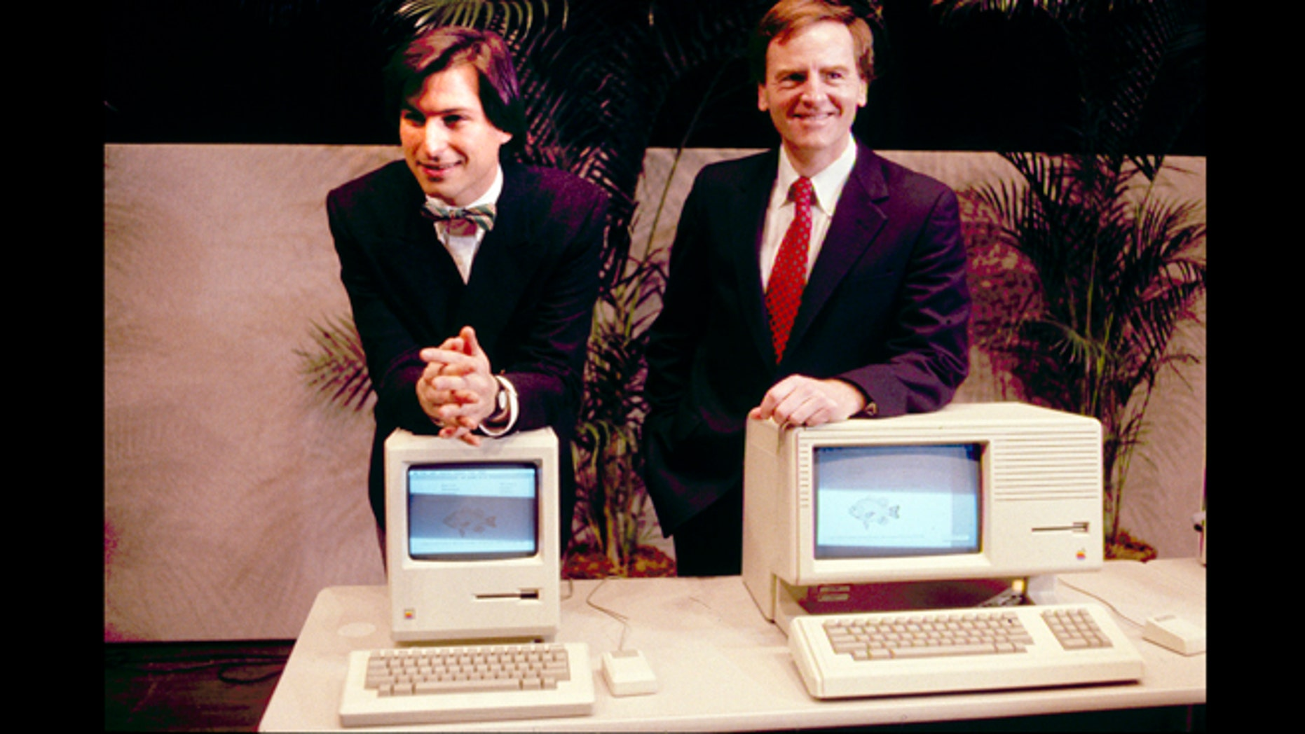 This January 1984 photo shows Apple CEO Steven P. Jobs, left and President John Sculley presenting the new Macintosh Desktop Computer in January 1984 at a shareholder meeting in Cupertino, Calif. January 24, 2014, marks thirty years after the first Mac computer was introduced.