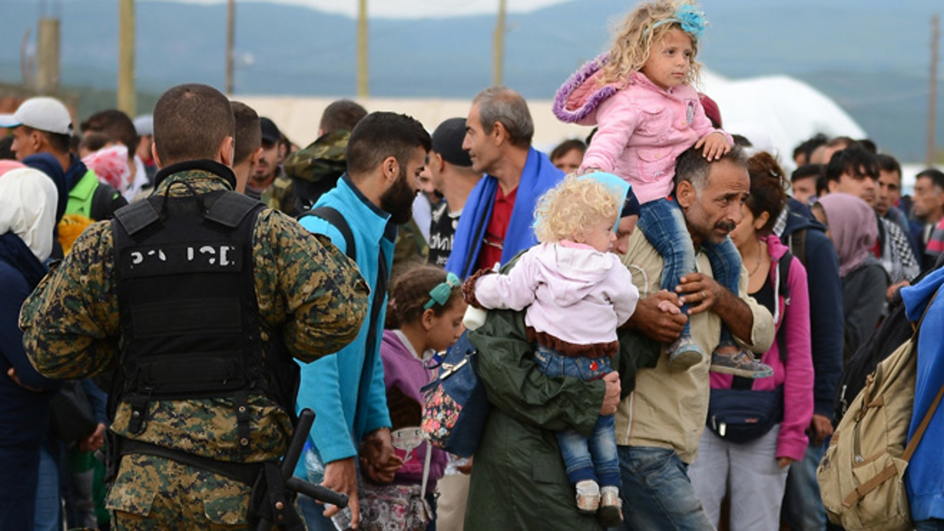 Sept. 8, 2015: People gather at a refugee camp in the southern Macedonian town of Gevgelija.