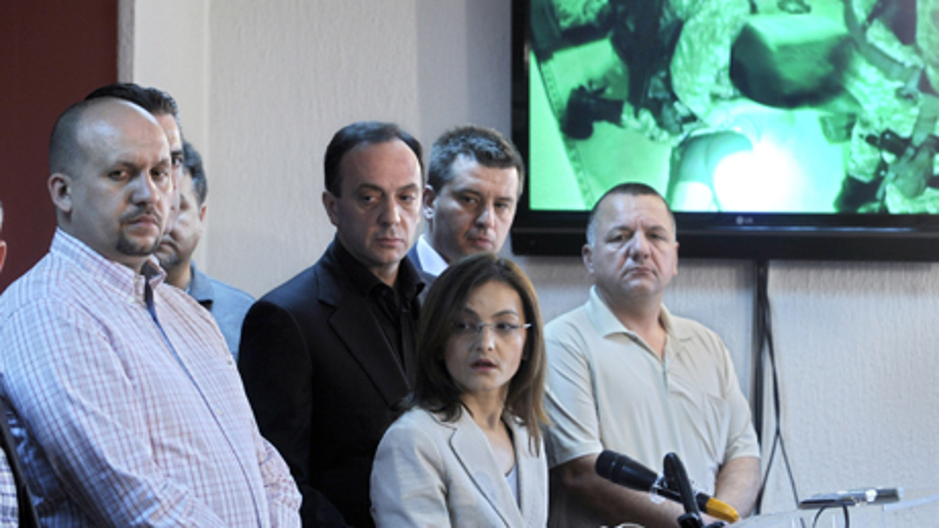 May 1, 2012: Macedonian Interior Minister Gordana Jankuloska, center front, talks to the media surrounded by her associates during a news conference in the capital Skopje. Macedonian authorities say they have arrested 20 people, all radical Islamists, in the murder of five Macedonian fishermen last month that fueled ethnic tensions in this tiny Balkan country. They have been charged with terrorism. (AP)