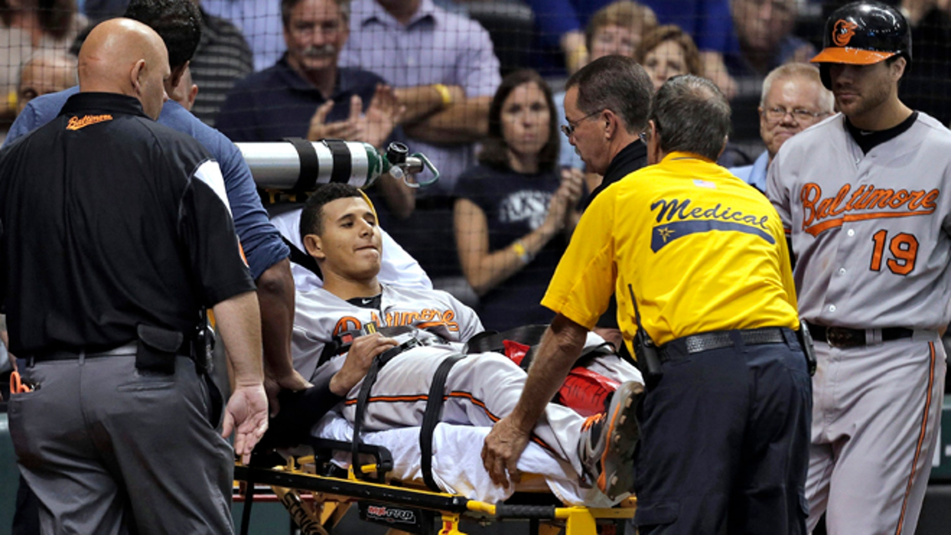 Baltimore Orioles' Manny Machado is taken off the field on a stretcher after injuring his left leg while running to first base on a seventh-inning single off Tampa Bay Rays relief pitcher Jake McGee during a baseball game Monday, Sept. 23, 2013, in St. Petersburg, Fla. (AP Photo/Chris O'Meara)