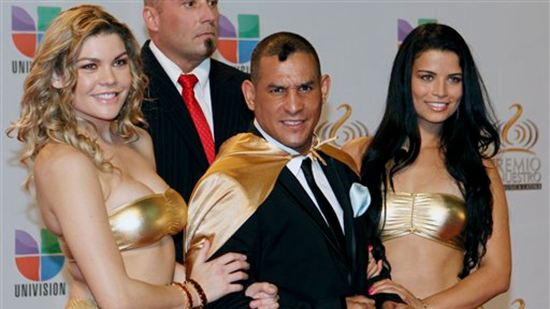 """Feb. 16, 2012 : Former boxing champion Hector """"Macho"""" Camacho, front center, poses for photographers at his arrival to the Premio Lo Nuestro Music Awards in Miami."""
