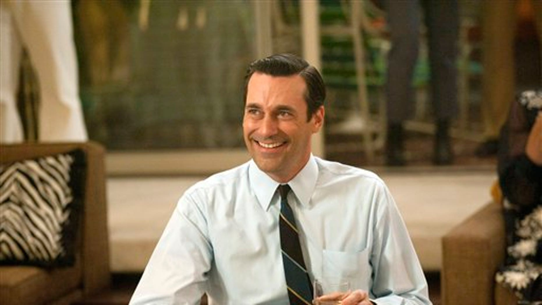 "FILE - In this file photo released by AMC, Jon Hamm portrays advertising executive Don Draper in a scene from the fifth season premiere of ""Mad Men."""