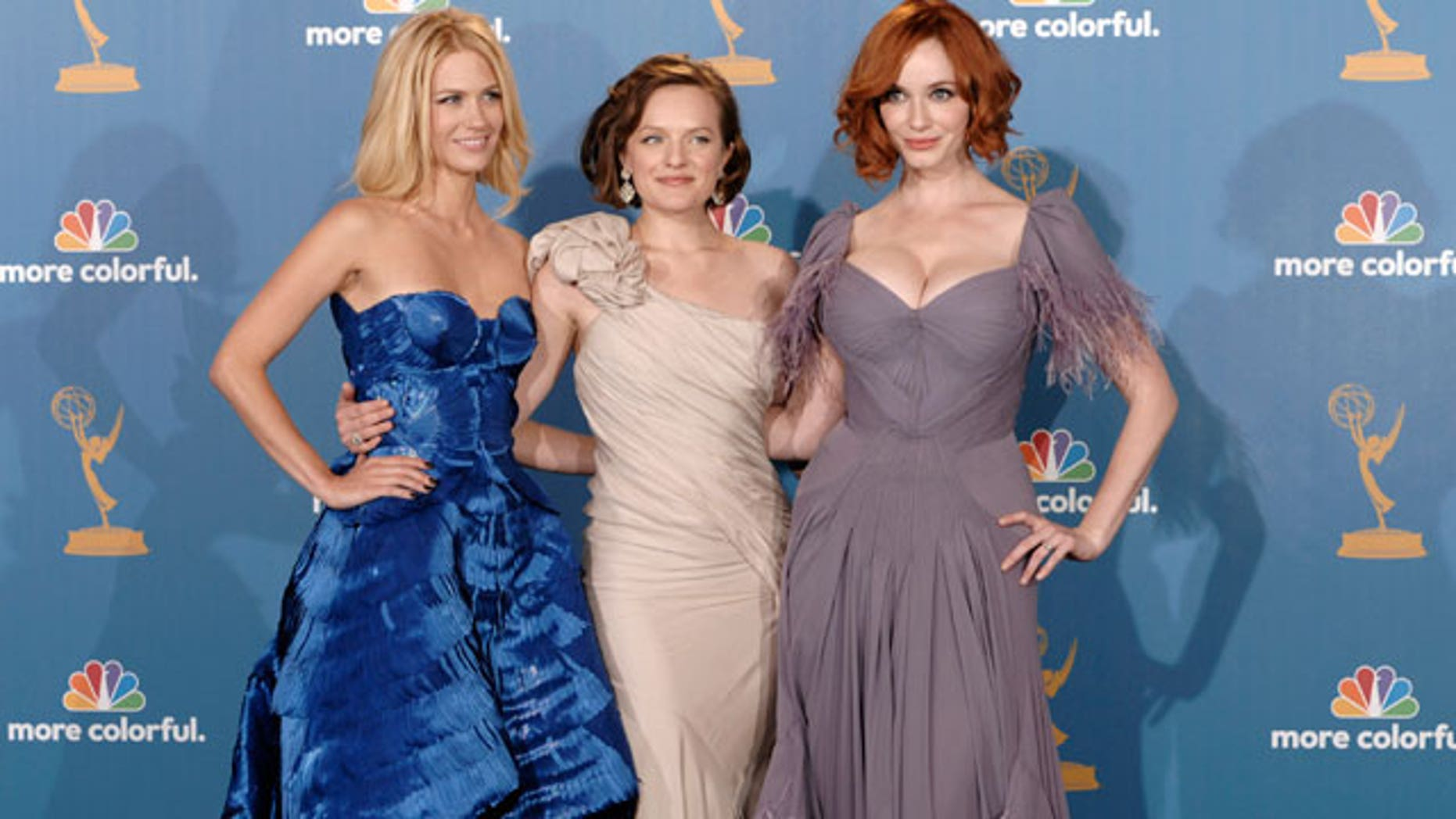 Aug. 29: January Jones, Elisabeth Moss and Christina Hendricks pose backstage at the Emmy Awards.  January Jones is the face of Versace's new ad campaign.