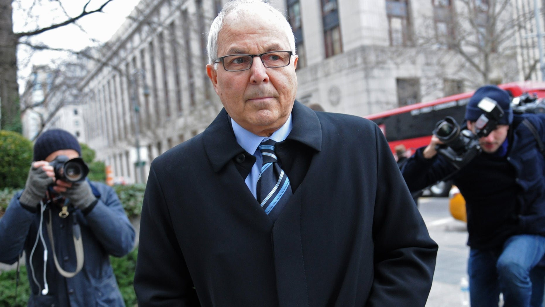 Dec. 20, 2012: Peter Madoff arrives at Manhattan federal court for his sentencing in New York. Madoff, the former senior compliance officer at the Madoff private investment business and brother of Ponzi king Bernard Madoff, pleaded guilty to conspiracy and falsifying books and records of an investment adviser in June.
