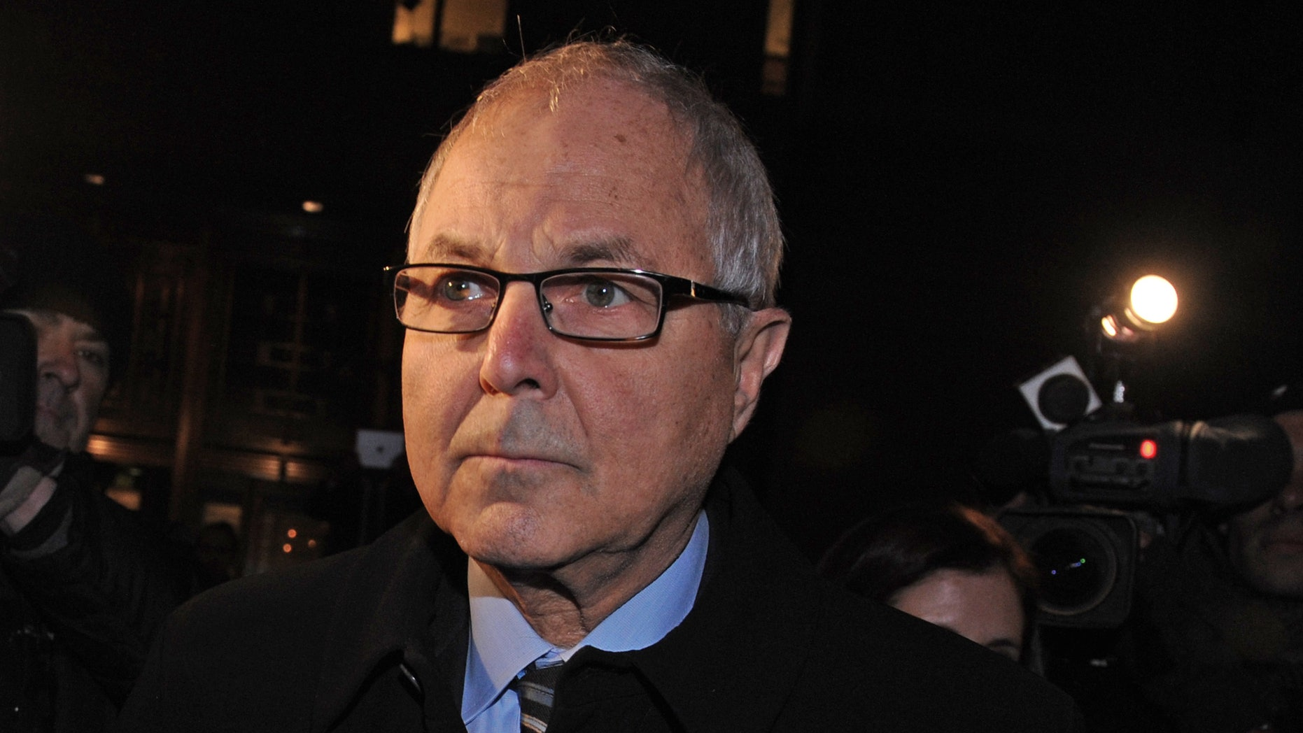 Dec. 20, 2012: Peter Madoff exits Manhattan federal court after receiving a 10 year sentence for his participation in the largest Ponzi scheme in history, in New York.