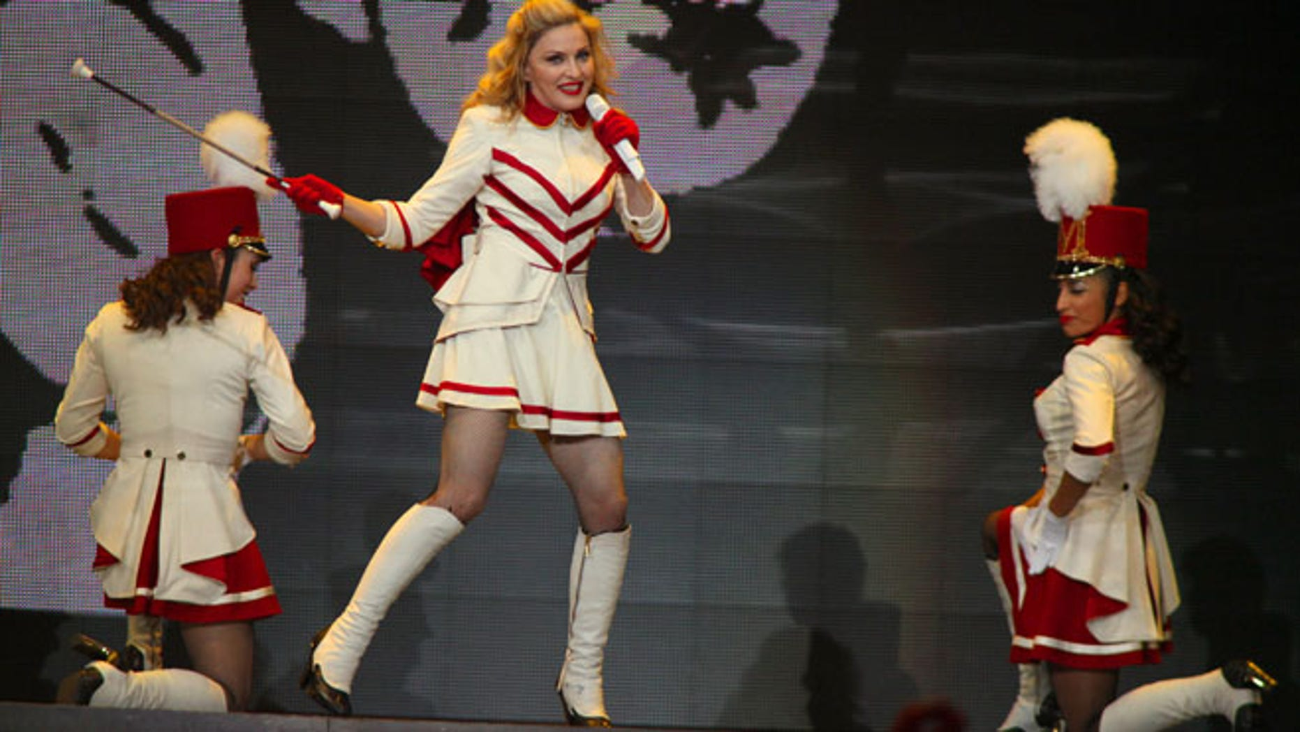 Madonna, shown here at the United Center in Chicago on Sept. 19, offered to strip to win votes for Obama during a concert at Washington's Verizon center.