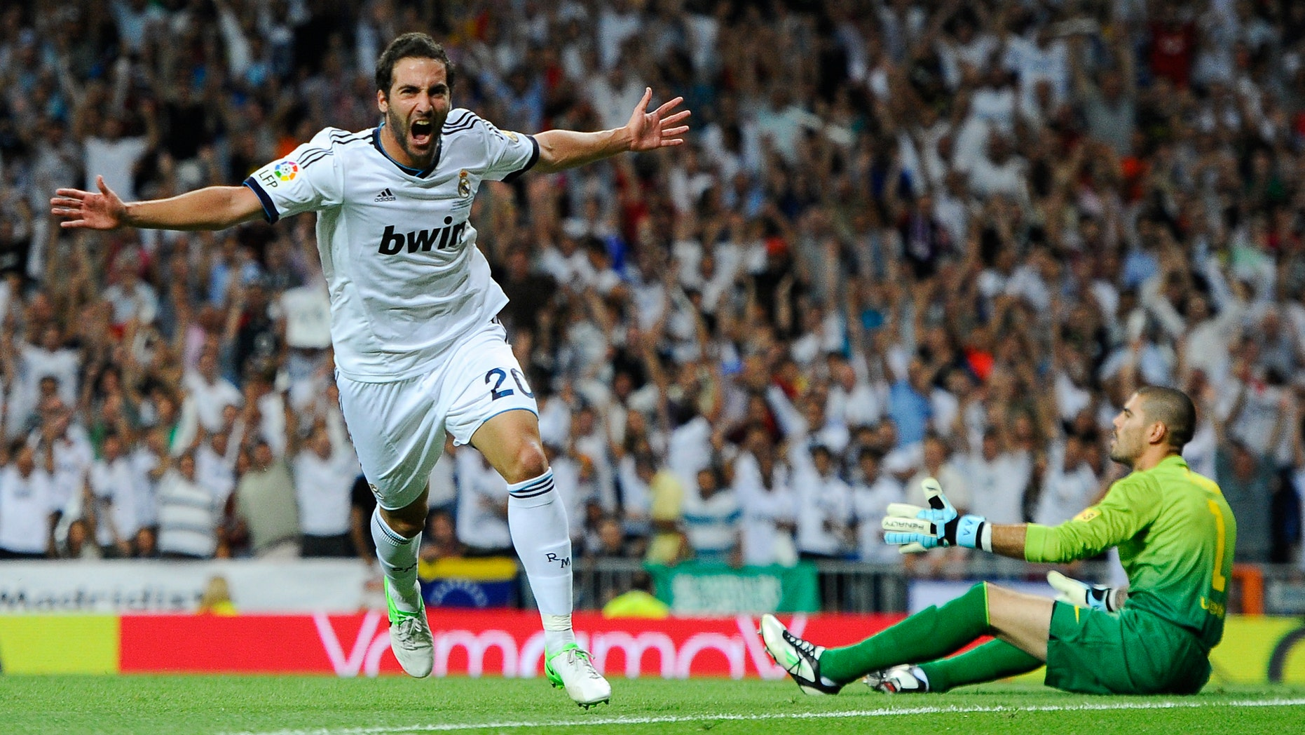 MADRID, SPAIN - AUGUST 29:  Gonzalo Higuain of Real Madrid CF celebrates after scoring the opening goal during the Super Cup second leg match betwen Real Madrid and FC Barcelona at Estadio Santiago Bernabeu on August 29, 2012 in Madrid, Spain.  (Photo by David Ramos/Getty Images)