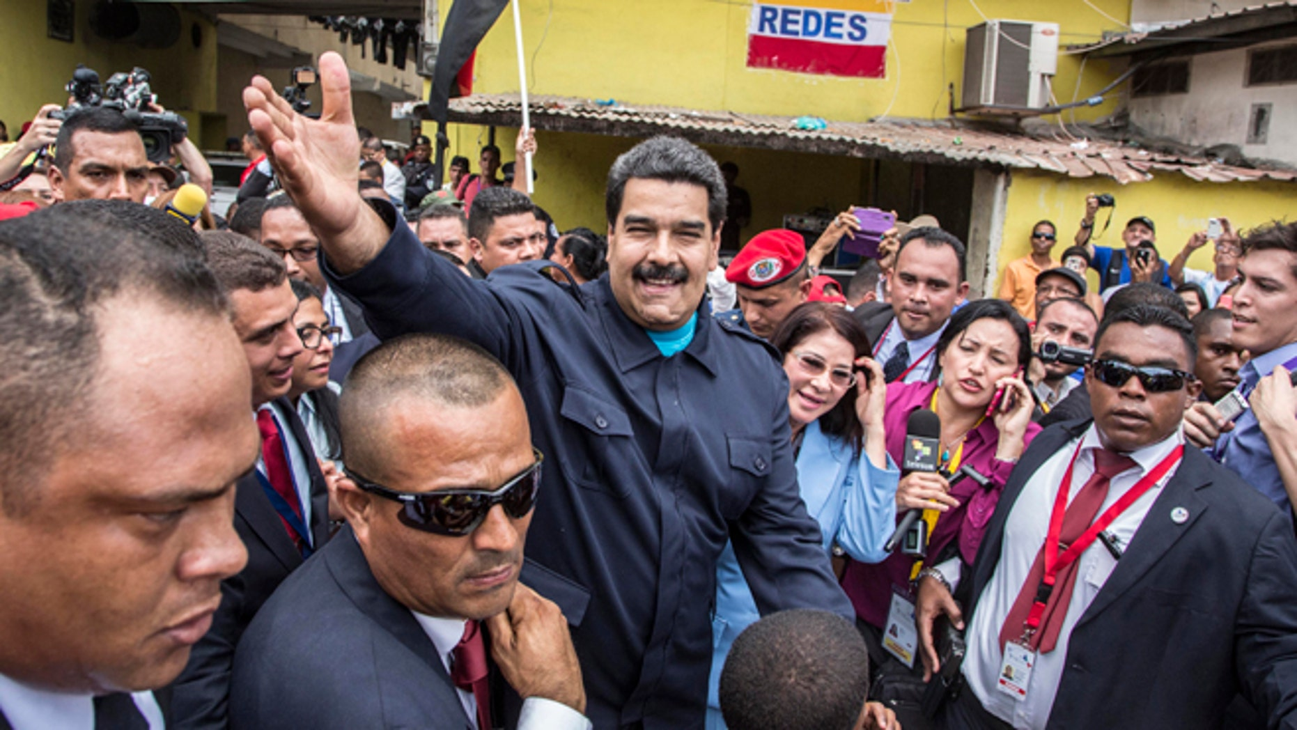 """Venezuela's President Nicolas Maduro greets supporters before a ceremony at a monument in  honor of the victims of the 1989 U.S. invasion, in the Chorrillo neighborhood which saw the heaviest fighting during the invasion, in Panama City, Friday, April 10, 2015. A crowd of several hundred chanted in Spanish, """"Maduro, stick it to the Yankee!"""" (AP Photo/Ramon Espinosa)"""
