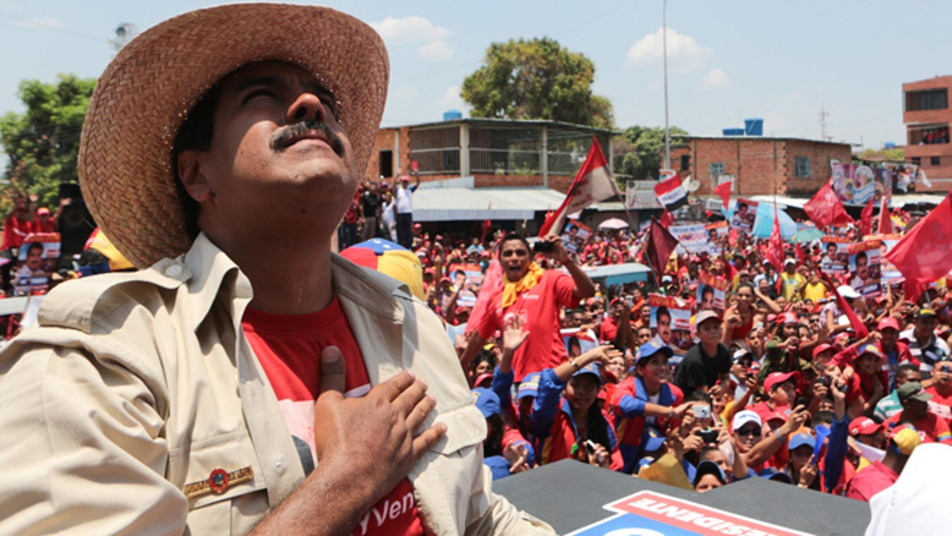 President Nicolas Maduro looks up during a campaign rally in San Fernando de Apure, Venezuela, Sunday, April 7, 2013.