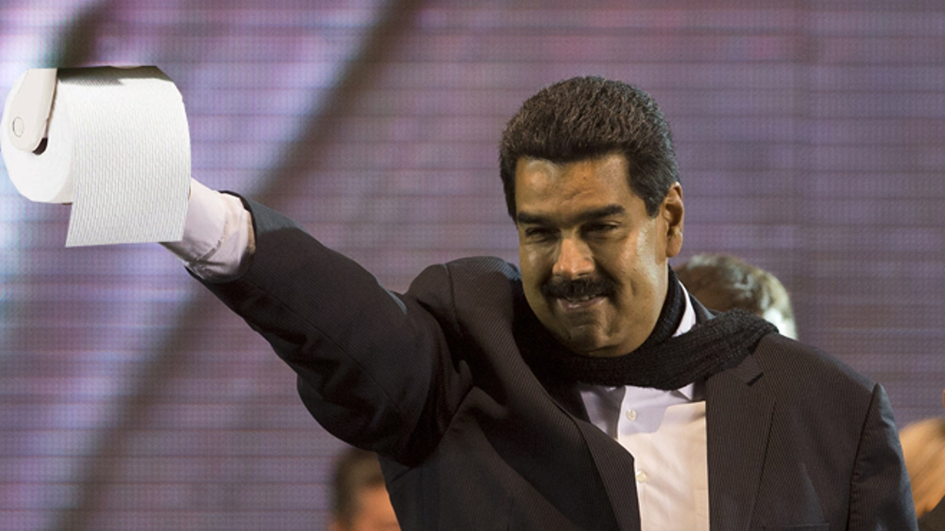 Venezuela's President Nicolas Maduro flashes a victory sign during a rally in Buenos Aires, Argentina, Wednesday, May 8, 2013. Maduro said Venezuela and Argentina are more closely aligned than ever despite the deaths of Venezuelan President Hugo Chavez and of Nestor Kirchner, the husband of President Cristina Fernandez who preceded her in the presidency. (AP Photo/Victor R. Caivano)