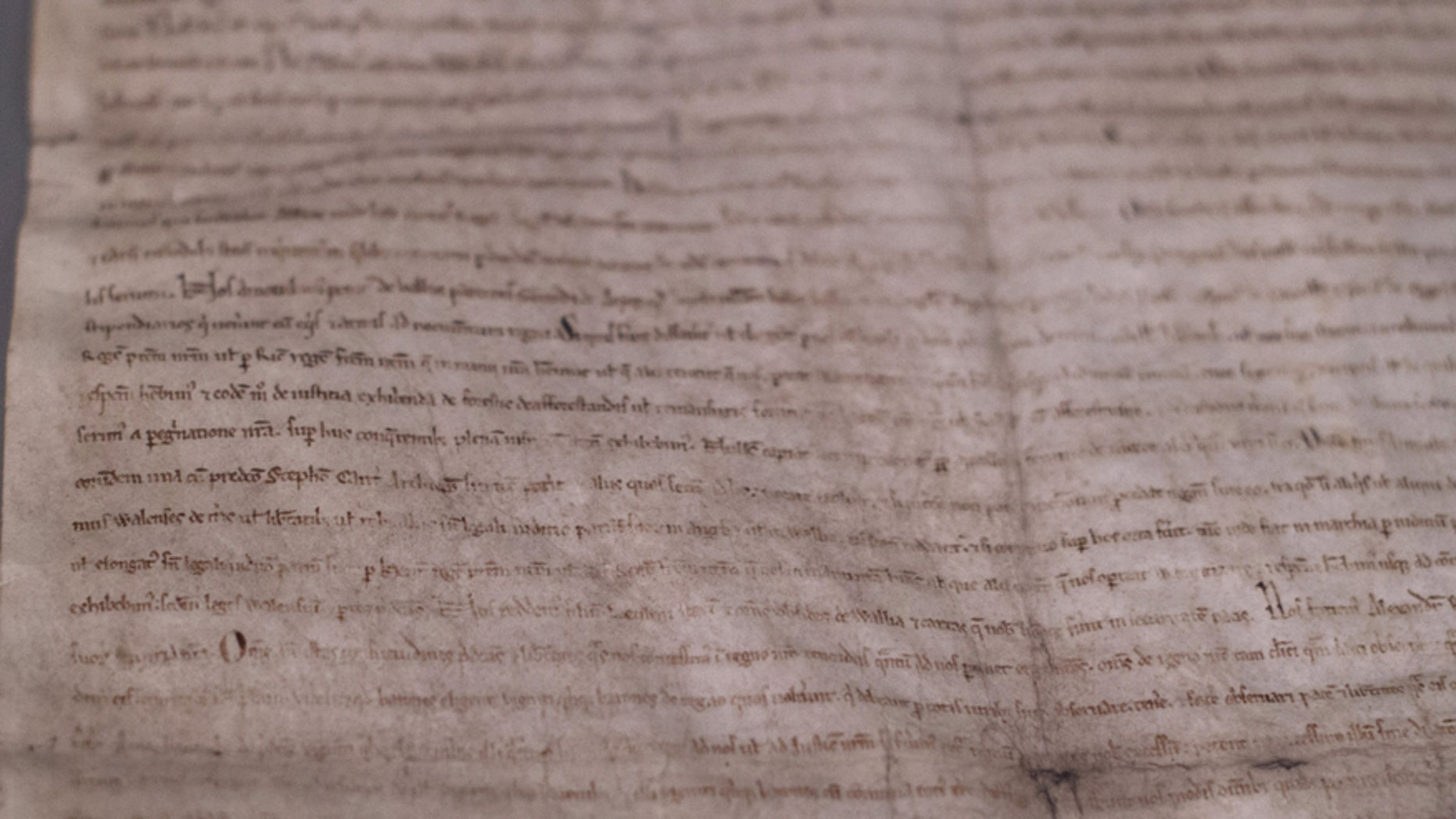A close-up view of one of four remaining copies of the original Magna Carta, a document written in 1215, is seen at the Museum of Fine Arts in Boston June 30, 2014.