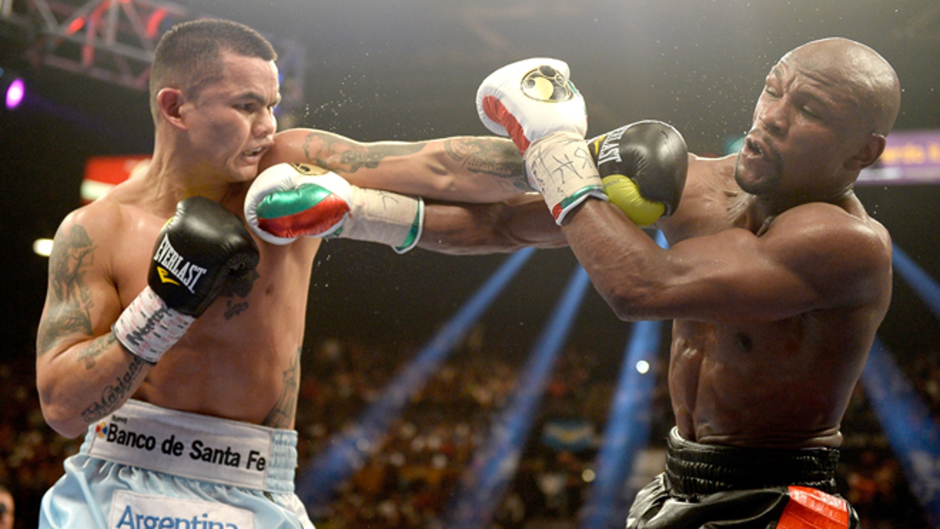 Marcos Maidana and  Floyd Mayweather Jr. at the MGM Grand Garden Arena on May 3, 2014 in Las Vegas, Nevada.