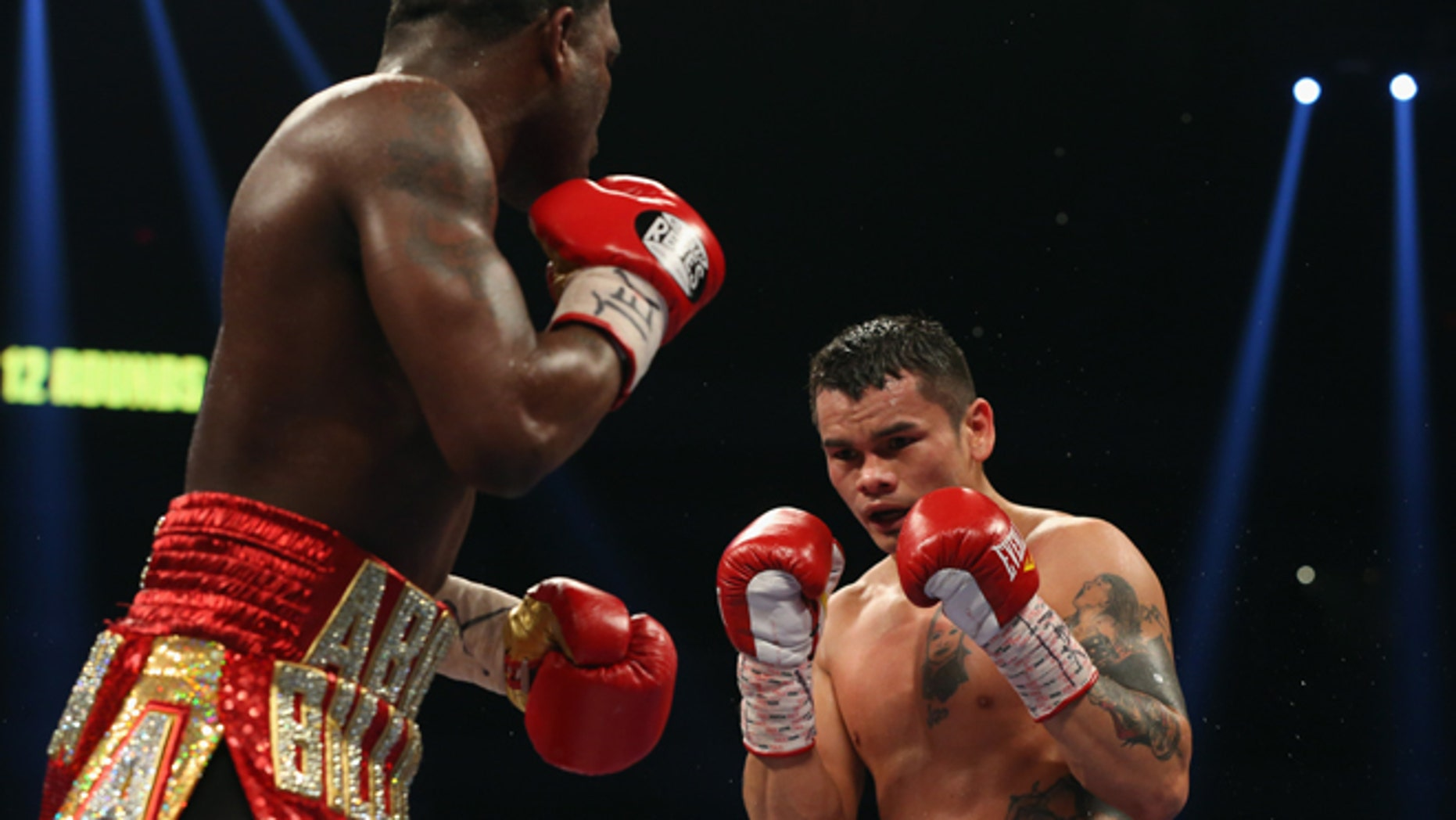 SAN ANTONIO, TX - DECEMBER 14:  (L-R) Adrien Broner and Marcos Maidana during their WBA Welterweight Title bout at Alamodome on December14, 2013 in San Antonio, Texas..  (Photo by Ronald Martinez/Getty Images)