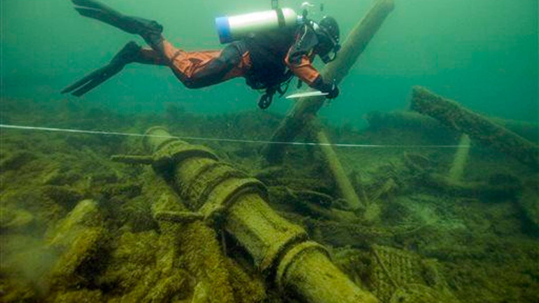 In a 2007 file photo provided by the NOAA, Thunder Bay National Marine Sanctuary, a diver swims over another shipwreck in Michigan.