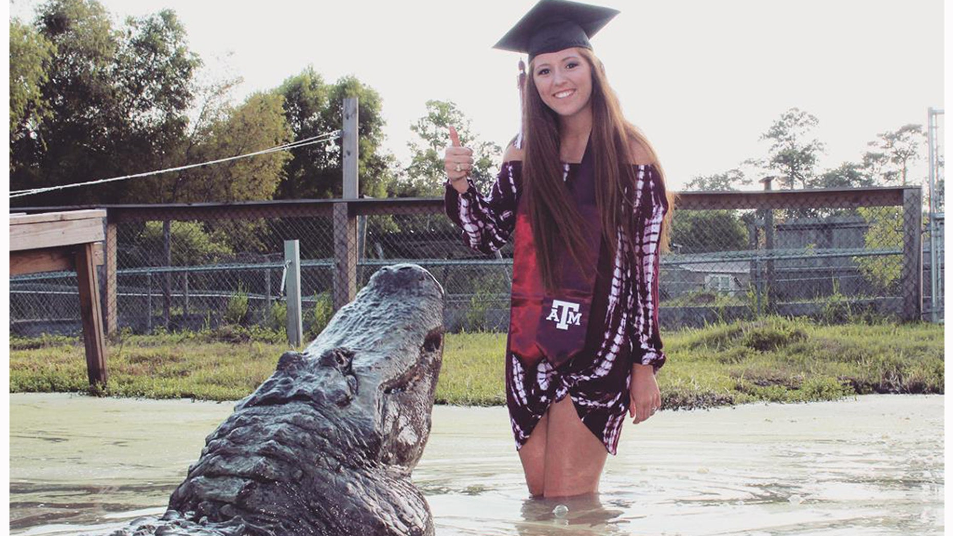 "Makenzie Noland, 21, poses with a gator named ""Big Tex"" at Gator Country in Beaumont, Texas, on August 3, 2018."