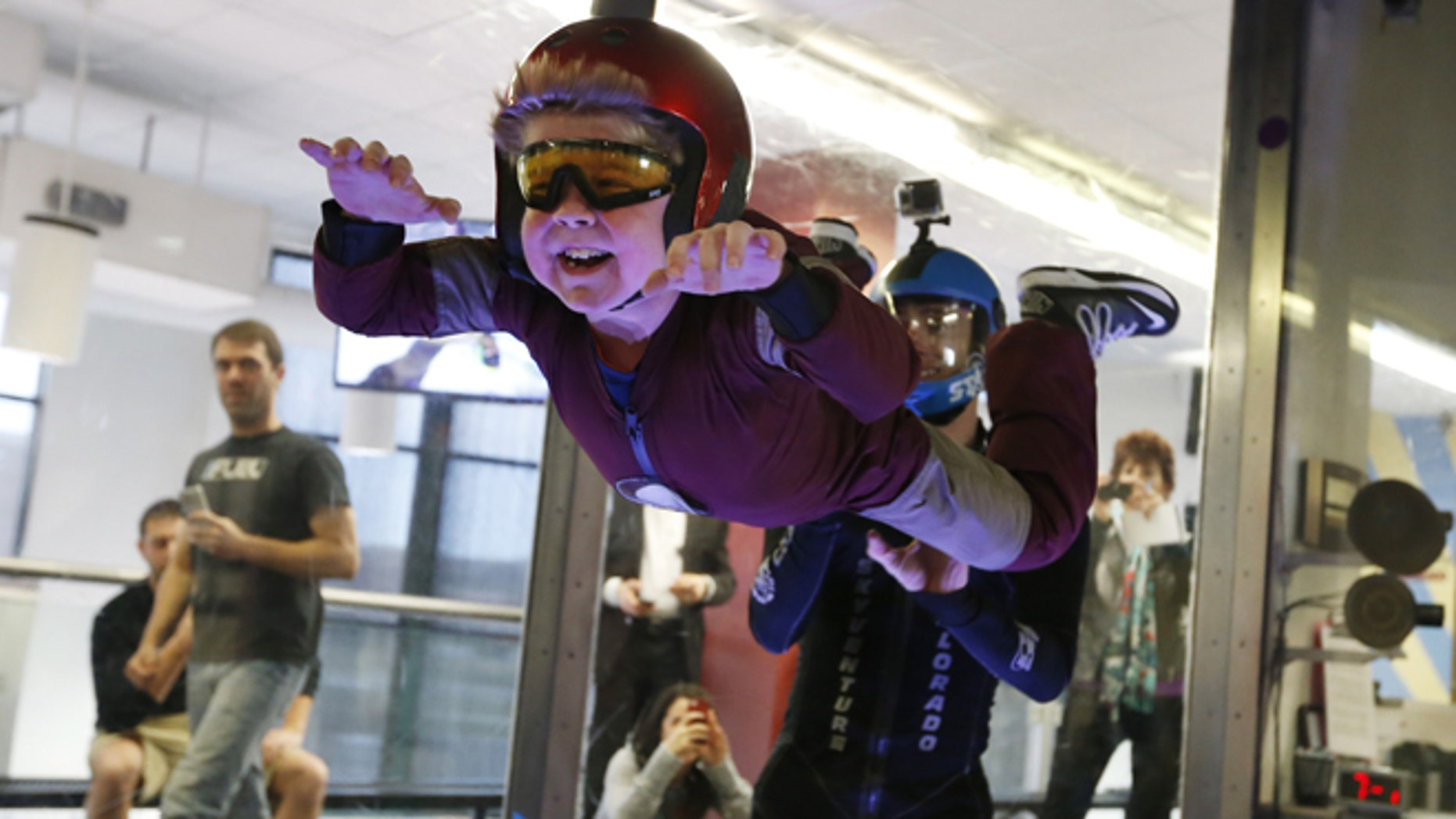 April 15: Wearing an Iron Man costume, Max Vertin, 7, from Hastings, Neb., floats in a wind tunnel simulating free fall during a day hosted by the Make-A-Wish Foundation at SkyVenture Colorado in Lone Tree, Colo.
