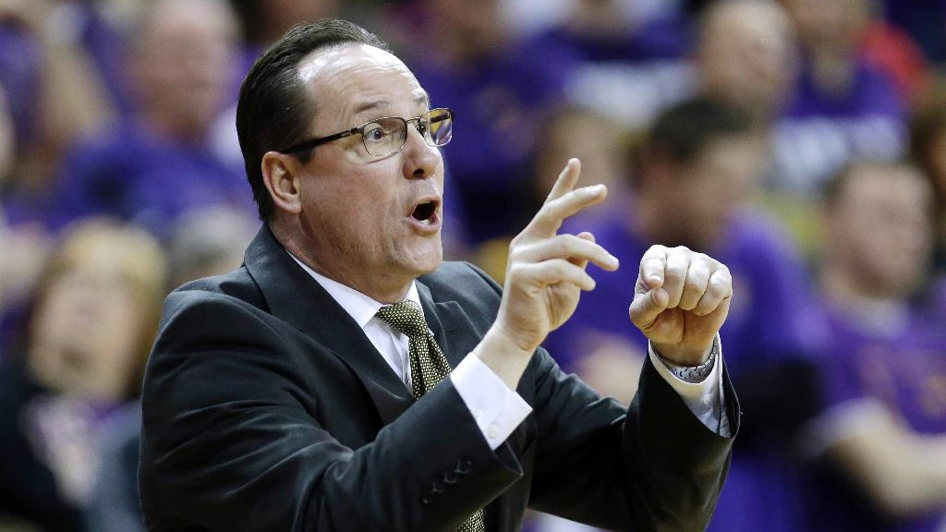FILE - In this Feb. 8, 2014 file photo, Wichita State head coach Gregg Marshall directs his team during the second half of an NCAA college basketball game against Northern Iowa, in Cedar Falls, Iowa. Gregg Marshall didn't learn on the knee of Mike Krzyzewski or Bob Knight. He didn't get his start at UCLA or Kentucky. No, the Wichita State coach cut his teeth at places like Randolph-Macon, Belmont Abbey and the College of Charleston, giving a unique twist to his story of success. (AP Photo/Charlie Neibergall, File)