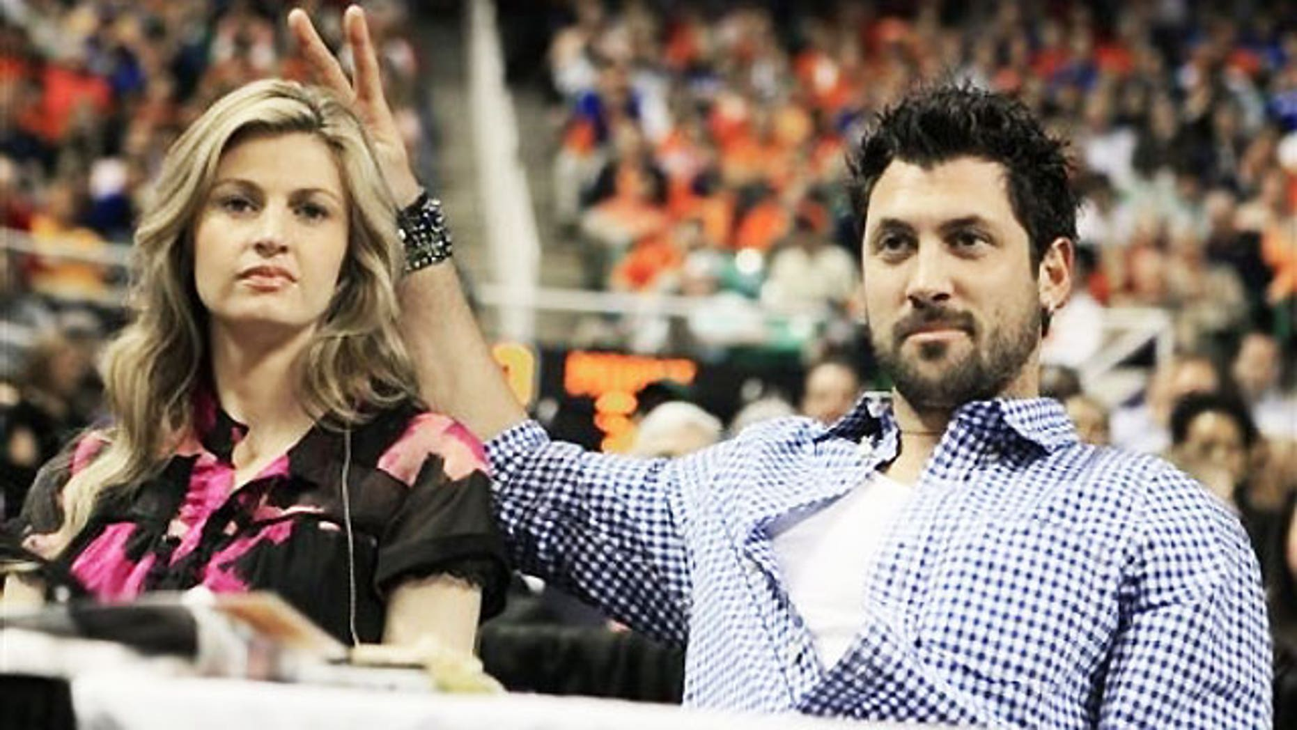 """March 13: ESPN broadcaster Erin Andrews, left, is seen with her """"DWTS"""" partner Maksim Chmerkovskiy during the second half of an NCAA college basketball game between Georgia Tech and North Carolina State in Greensboro, N.C."""