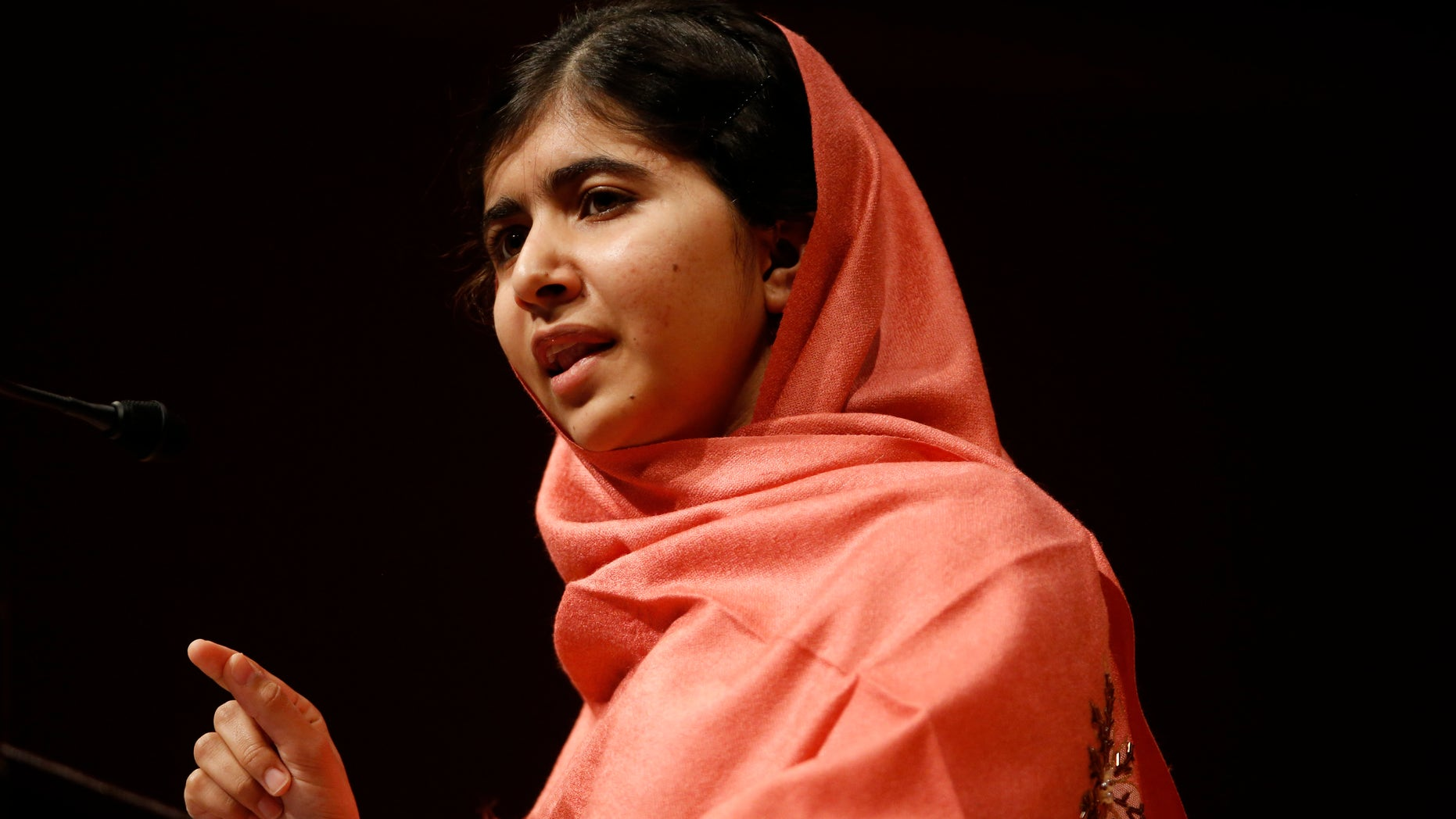 Sept. 27, 2013 - Malala Yousafzai addresses students and faculty after receiving the 2013 Peter J. Gomes Humanitarian Award at Harvard University  in Cambridge, Mass. The Pakistani teenager, an advocate for education for girls, survived a Taliban assassination attempt last year on her way home from school.
