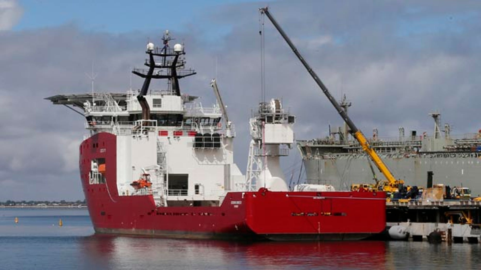 FILE - In this March 30, 2014 file photo, Australian navy ship Ocean Shield lies docked at naval base HMAS Stirling while being fitted with a towed pinger locator to aid in her roll in the search for missing Malaysia Airlines Flight MH370 in Perth, Australia. (AP Photo/Rob Griffith, File)