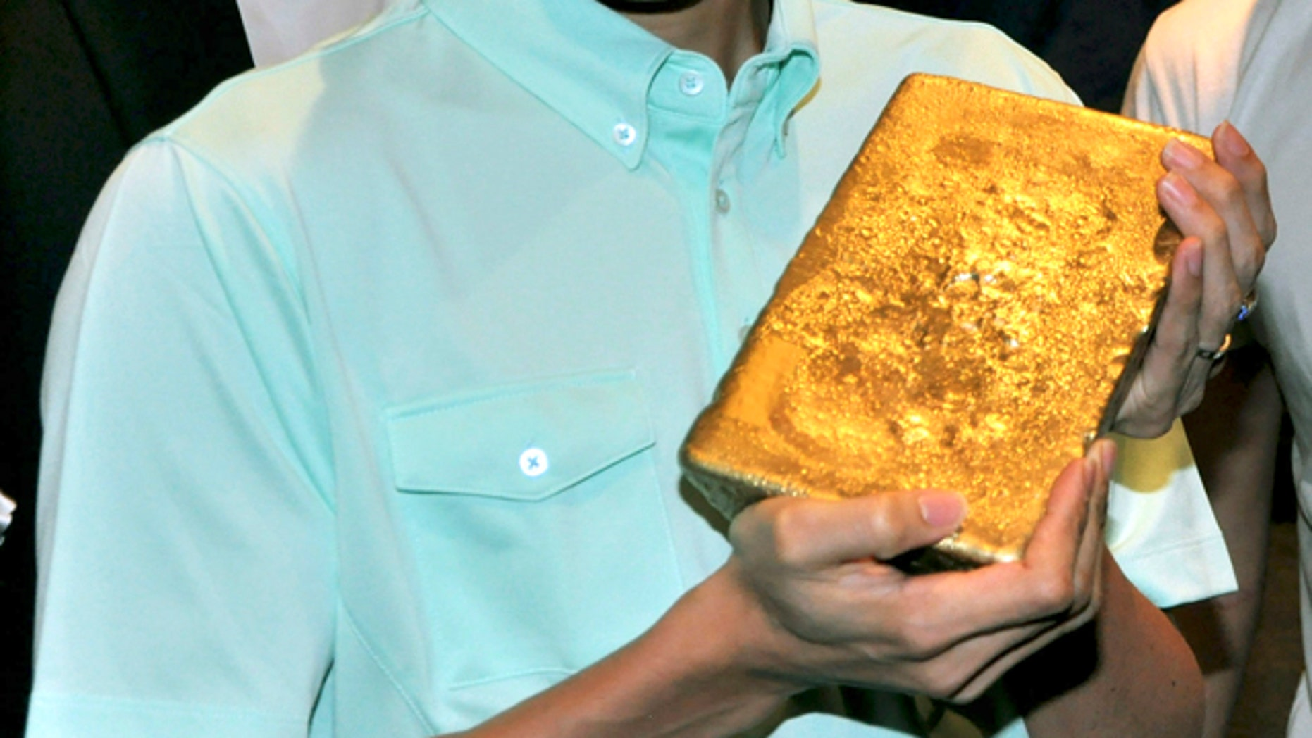 July 10, 2012: In this photo, Malaysian Olympic badminton player Lee Chong Wei holds a gold bar worth $627,795 during an incentive announcement for Olympic bound badminton players in Kuala Lumpur, Malaysia.