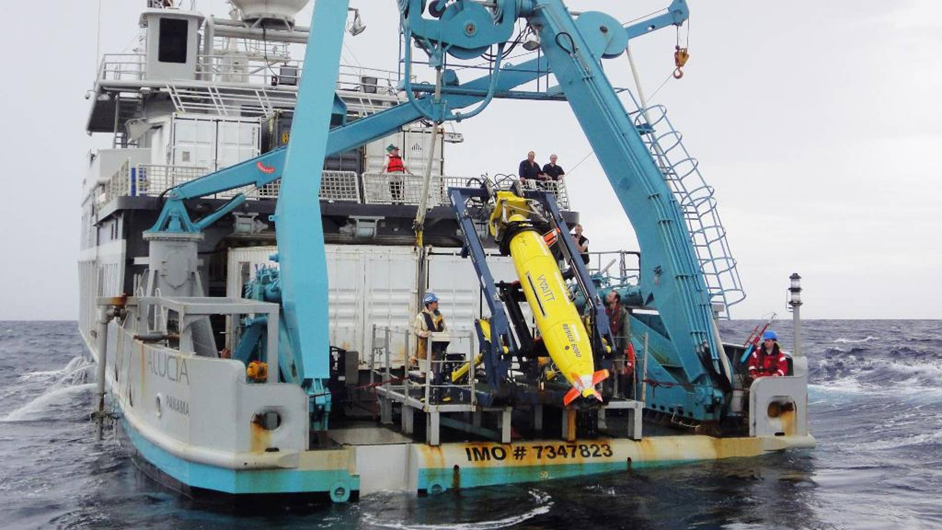 This 2011 photo provided by Sylvain Pascaud shows the ship Alucia and the REMUS 6000 robot sub during the search for Air France Flight 447. Unmanned subs, also called autonomous underwater vehicles or AUVs, played a critical role in locating the wreckage of the lost Air France jet, two years after it crashed in the middle of the south Atlantic. The find allowed searchers to recover the black boxes that revealed the malfunctions behind the tragedy. (AP Photo/Sylvain Pascaud)