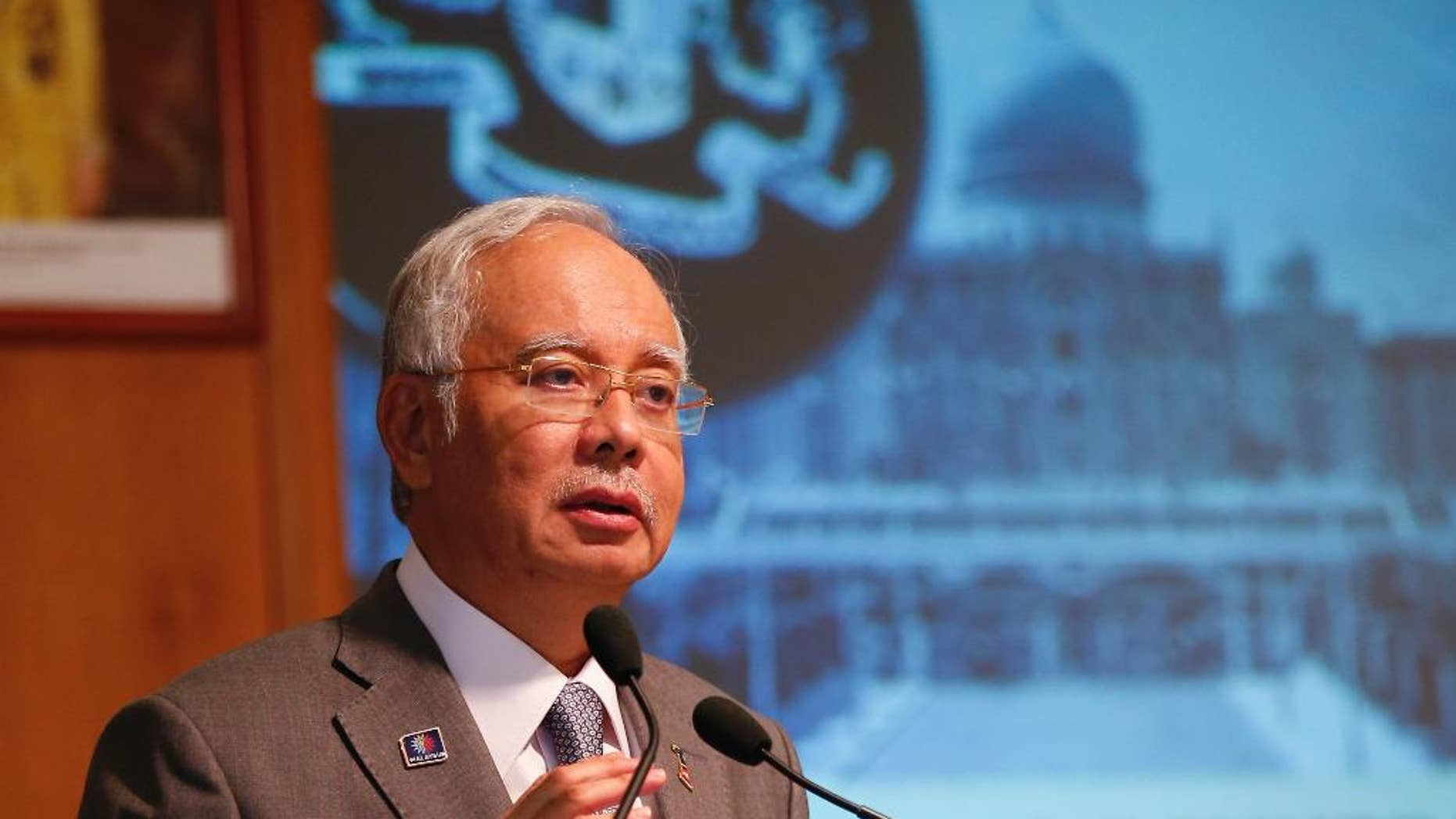FILE - In this  Wednesday, July 8, 2015 file picture t Malaysian Prime Minister Najib Razak speaks during Perdana Fellowship Programme in Putrajaya, Malaysia. Embattled Malaysian Prime Minister Najib Razak is not known to be a risk-taker, but he made his biggest political gamble to stay in power last week as he got rid of critics in his Cabinet, sacked the attorney-general probing him and stalled investigations over leaked confidential documents that allegedly show some $700 million was siphoned out from a troubled state fund into his personal accounts.   (AP Photo/Vincent Thian/FILE)