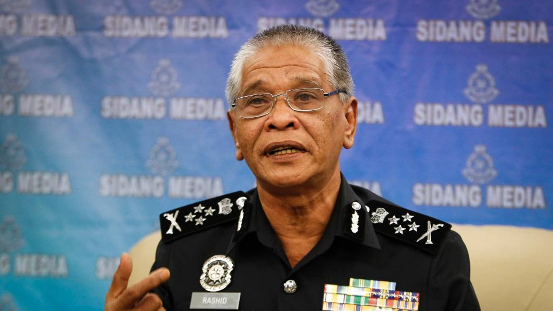 Malaysian police Deputy Inspector Gen. Noor Rashid Ibrahim gestures as he speaks during a press conference at the police headquarters in Kuala Lumpur, Malaysia Wednesday, Sept. 23, 2015. He says eight people, including four believed to be ethnic Uighurs, have been detained in connection with last month's bombing of a shrine in Bangkok that killed 20 people. (AP Photo/Joshua Paul)