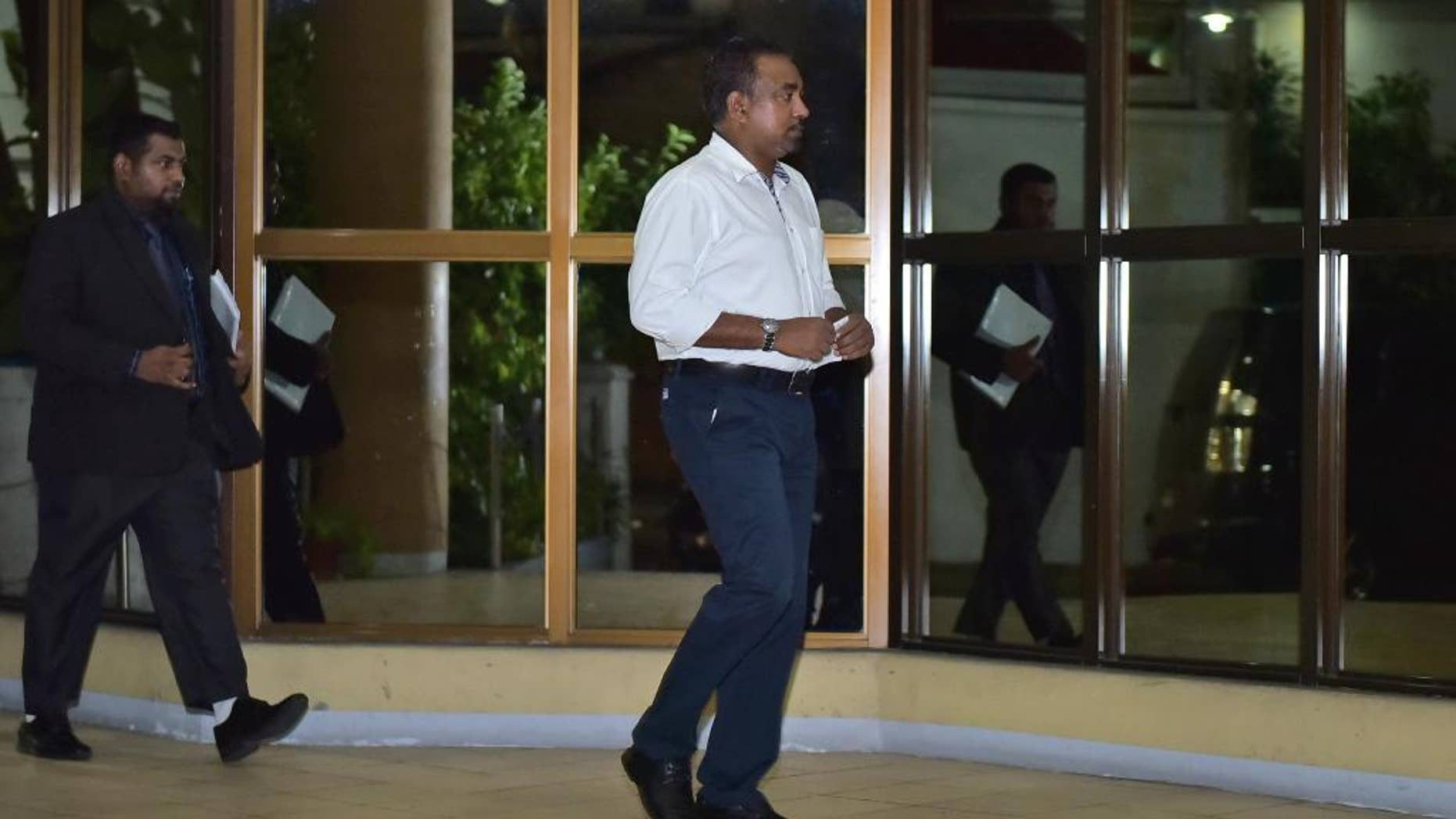 In this Friday, April 10, 2015 photo, Former defense minister Tholath Ibrahim arrives at the Criminal Court in Male, Maldives. The court sentenced Ibrahim to 10 years in prison on charges of detaining a senior judge, the same case in which former president Mohamed Nasheed has also been jailed in a trial widely criticized as politically motivated. (AP Photo/Mohamed Sharuhaan)