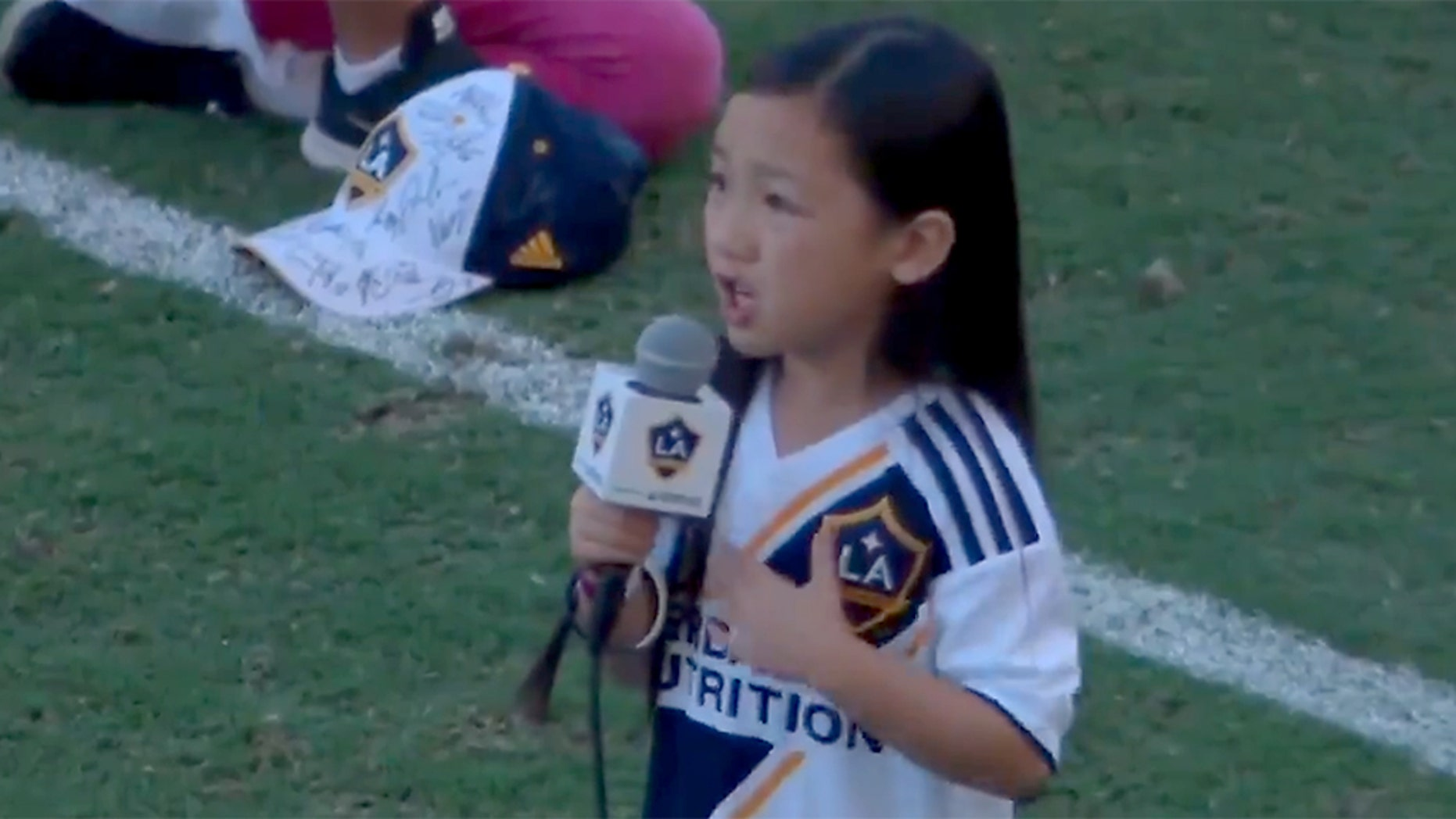 A now-viral video shows Malea Emma Tjandrawidjaja singing the national anthem before a LA Galaxy game on Sunday.