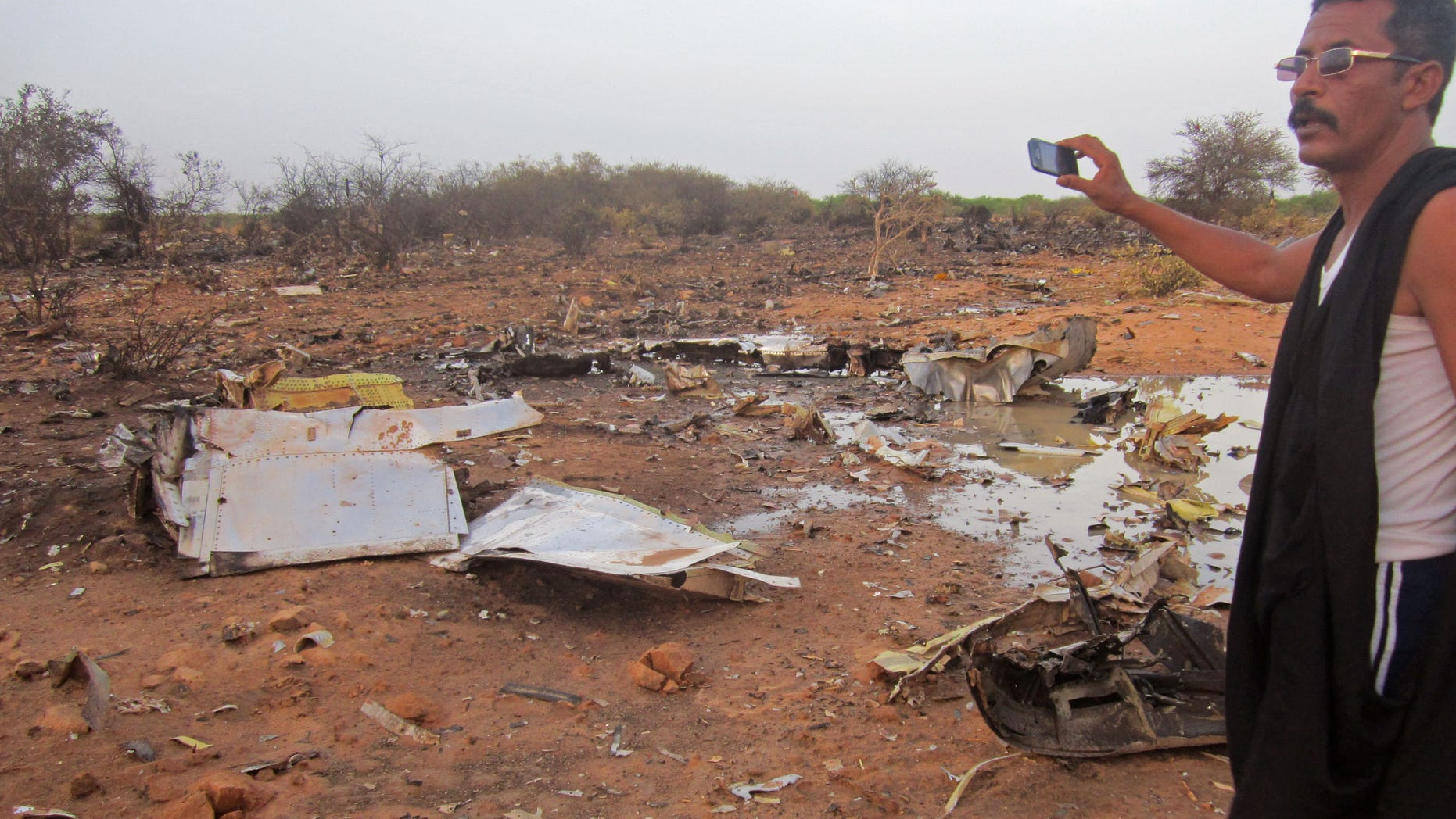 July 25, 2014 - French soldiers secured a black box from the Air Algerie wreckage site in a desolate region of restive northern Mali. The French president said terrorism hasn't been ruled out as a cause, although officials say the most likely reason for the catastrophe that killed all onboard is bad weather. At least 118 people were killed in the disaster, nearly half of whom were French.  (Burkina Faso military)