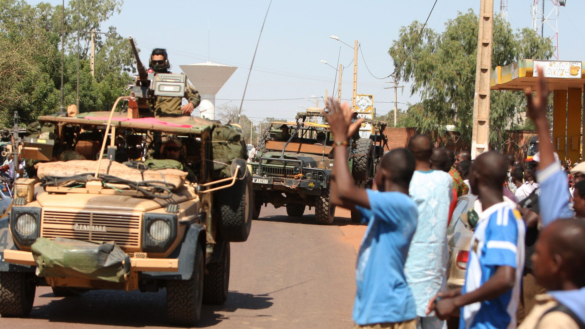 Jan. 18, 2013 - Residents of San in central Mali clap as French troops pass through en route to Sevare, Mali.