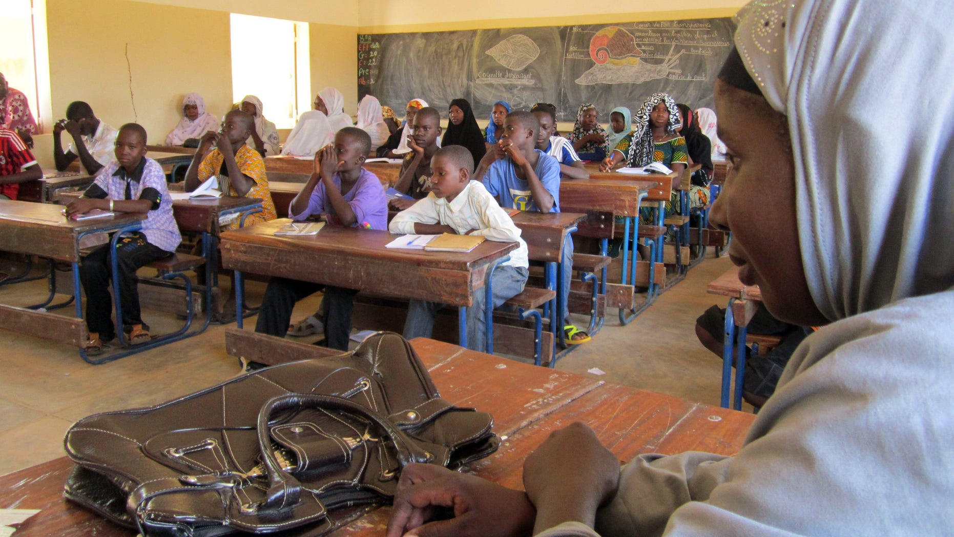 Sept. 27, 2012 - school children listen to a teacher during class in Douentza, Mali.