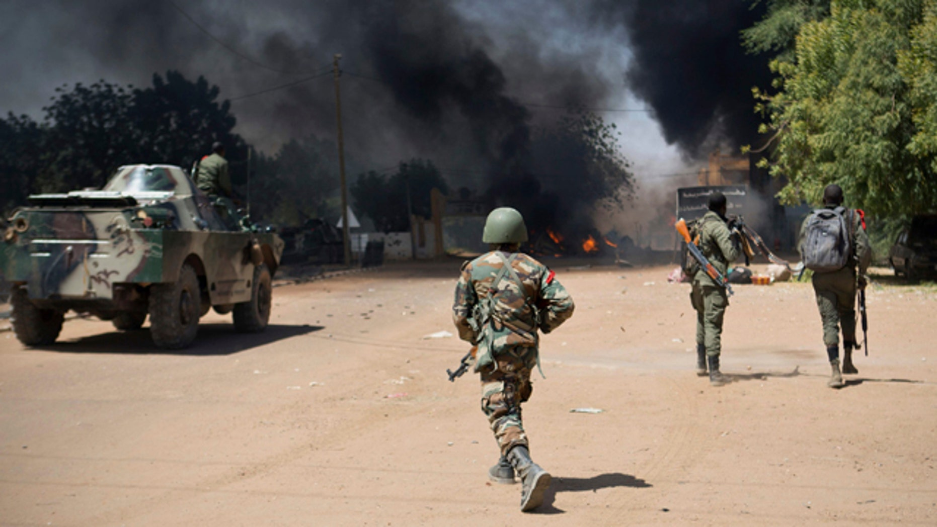 Feb. 21, 2013: Malian soldiers, working with French forces, battling radical Islamic rebels in Gao, Mali.