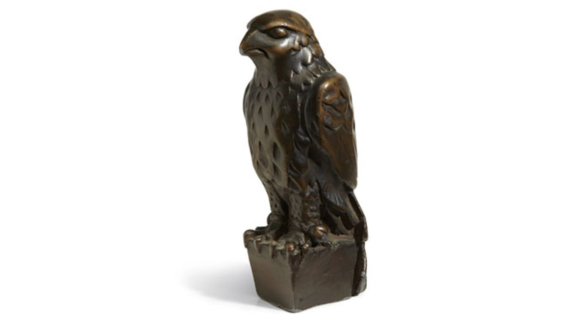 """November 25, 2013: In this undated photo provided by Bonham's Auction House, the """"Maltese Falcon"""" is shown. The 45-pound, 12-inch-tall, black figurine cast in lead that was specifically made for John Huston's screen version of the film bears its name, sold for more than $4 million at auction by Bonham's in New York. (AP Photo)"""