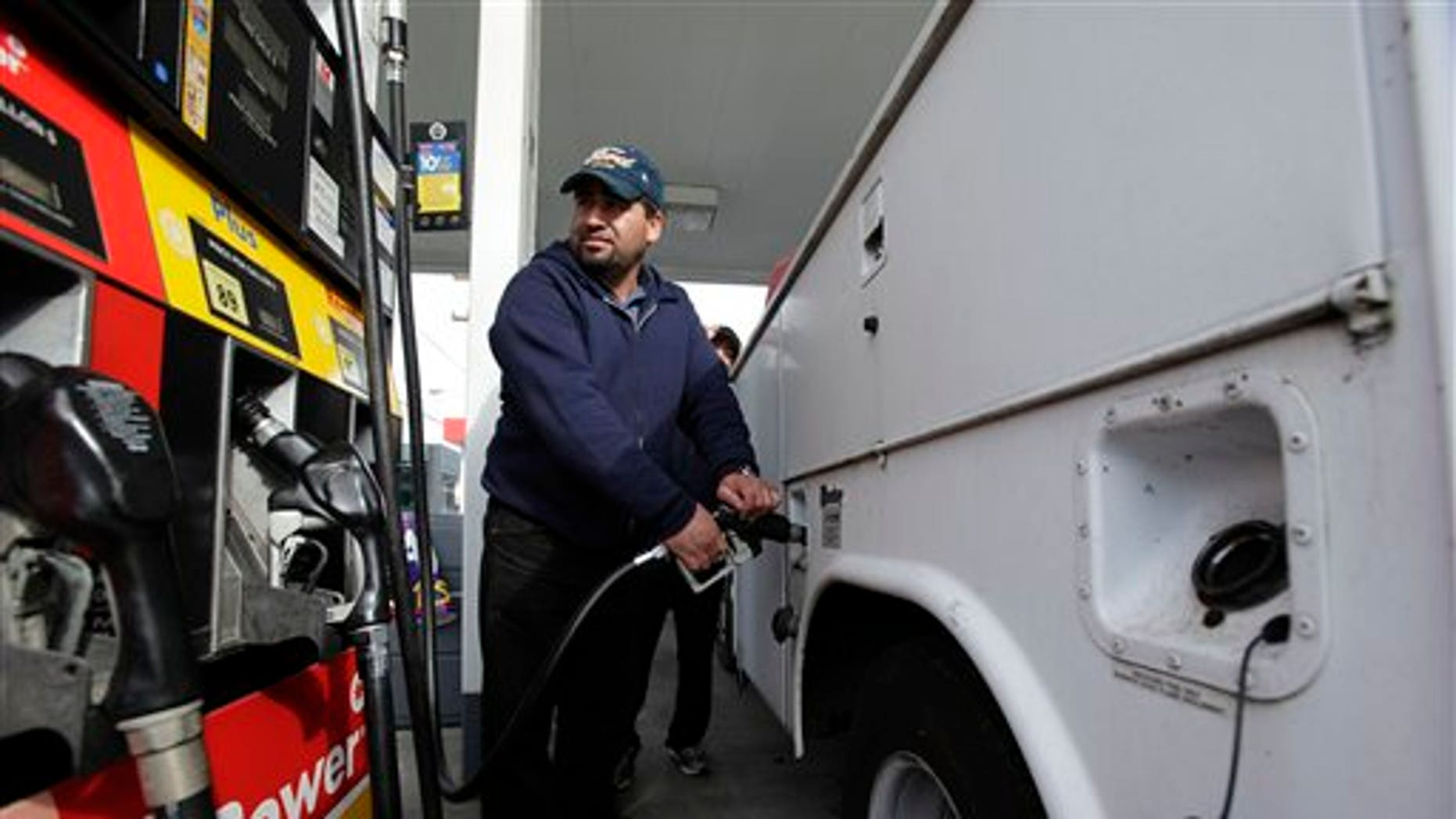 April 15: A motorist fills up his tank at a Shell gas station in Seattle.