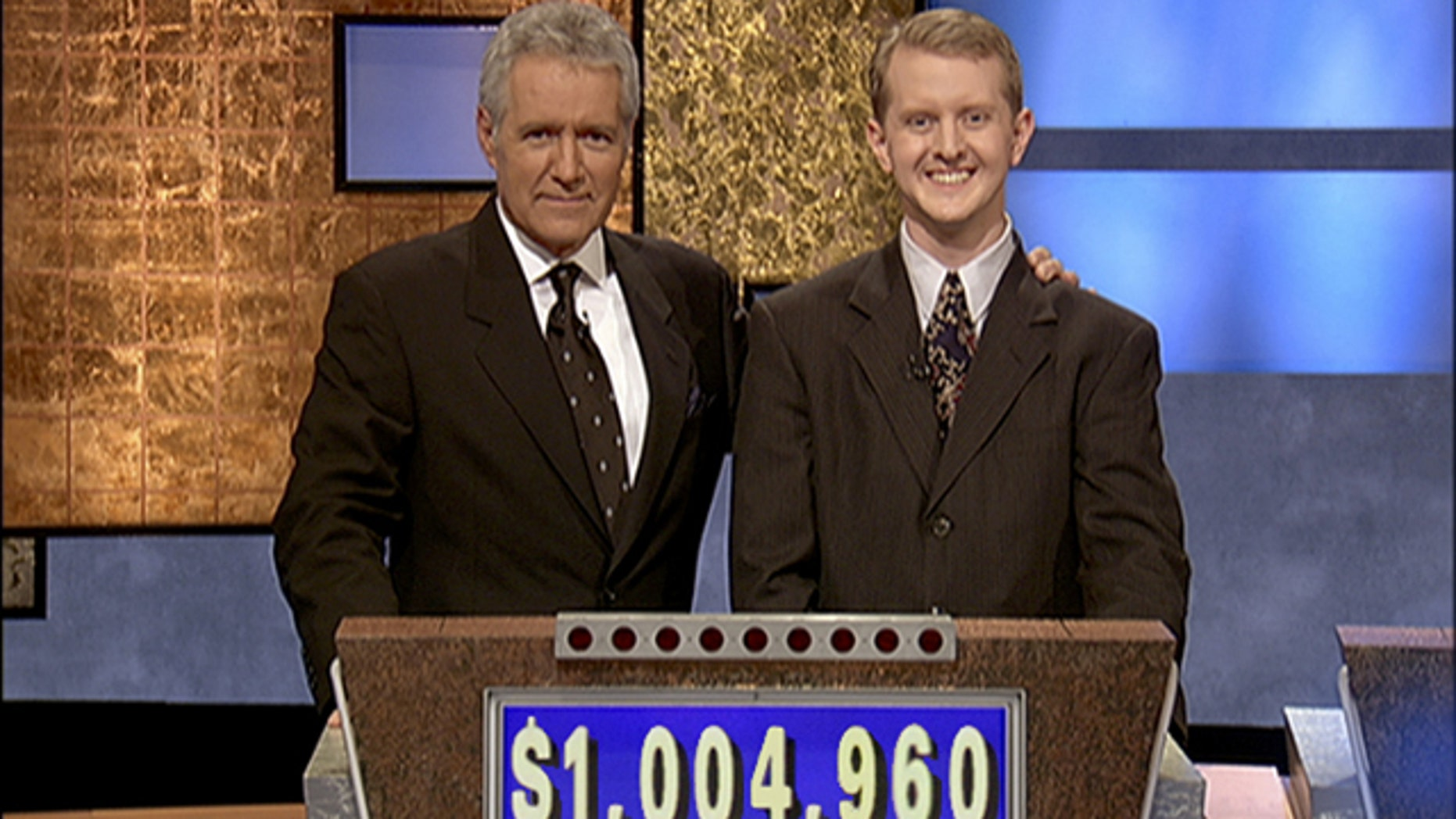 "Software developer Ken Jennings from Salt Lake City, Utah poses for a photo with Jeopardy host Alex Trebek on the set of the show in Culver City, Calif. On Thursday Jan. 13, 2011 IBM computer Watson will play a practice round against Jennings, who won a record 74 consecutive ""Jeopardy!"" games in 2004-05."