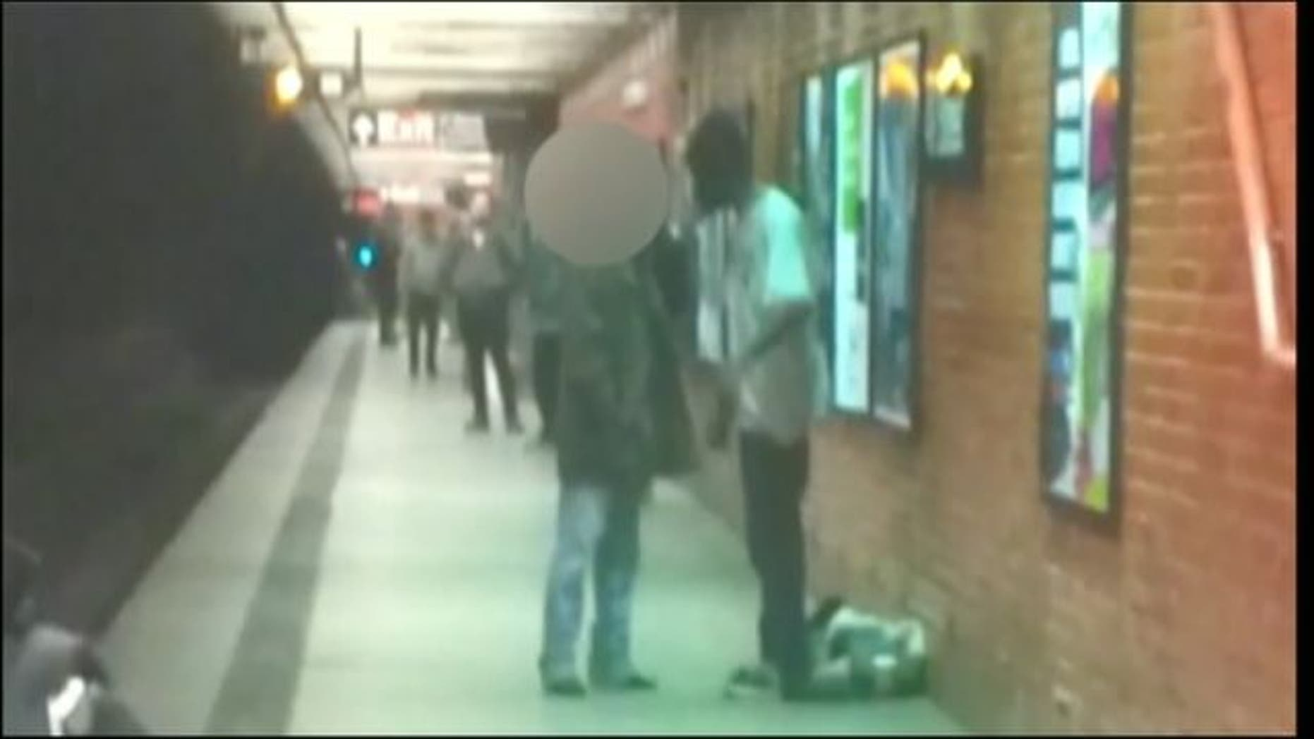 Dec. 3, 2012: An alleged suspect in subway train pushing and another man talk on platform.