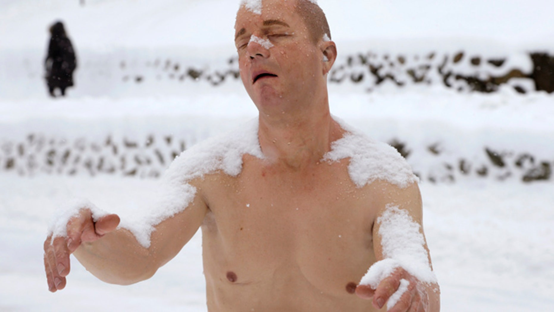 Feb. 5: A statue of a man sleepwalking in his underpants is surrounded by snow on the campus of Wellesley College, in Wellesley, Mass.