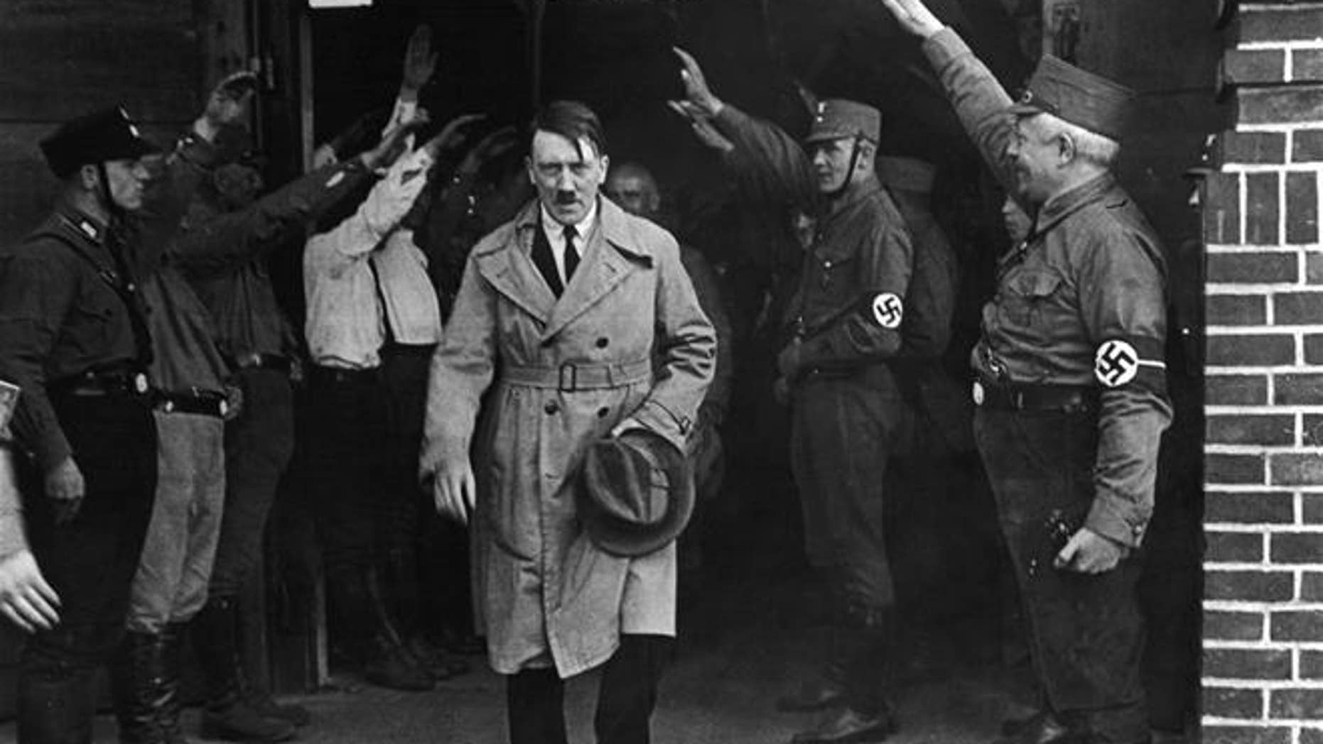 Adolf Hitler, leader of the National Socialists, emerges from the party's Munich headquarters.