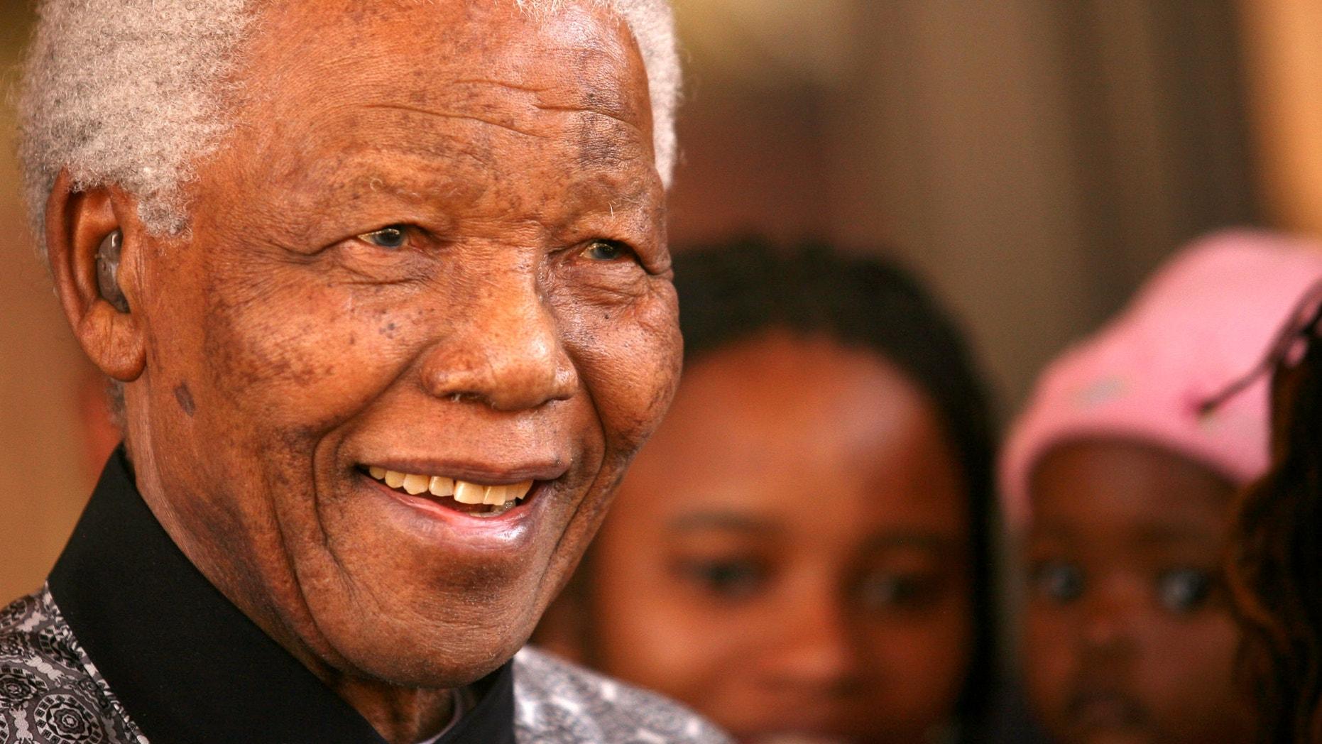 June 13, 2006  - FILE photo of former South African President Nelson Mandela in Johannesburg.