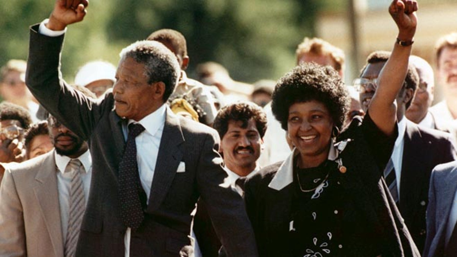 Feb. 11, 1990, In this file photo, Nelson Mandela and his wife, Winnie, raise clenched fists as they walk hand-in-hand upon his release from prison in Cape Town, South Africa.