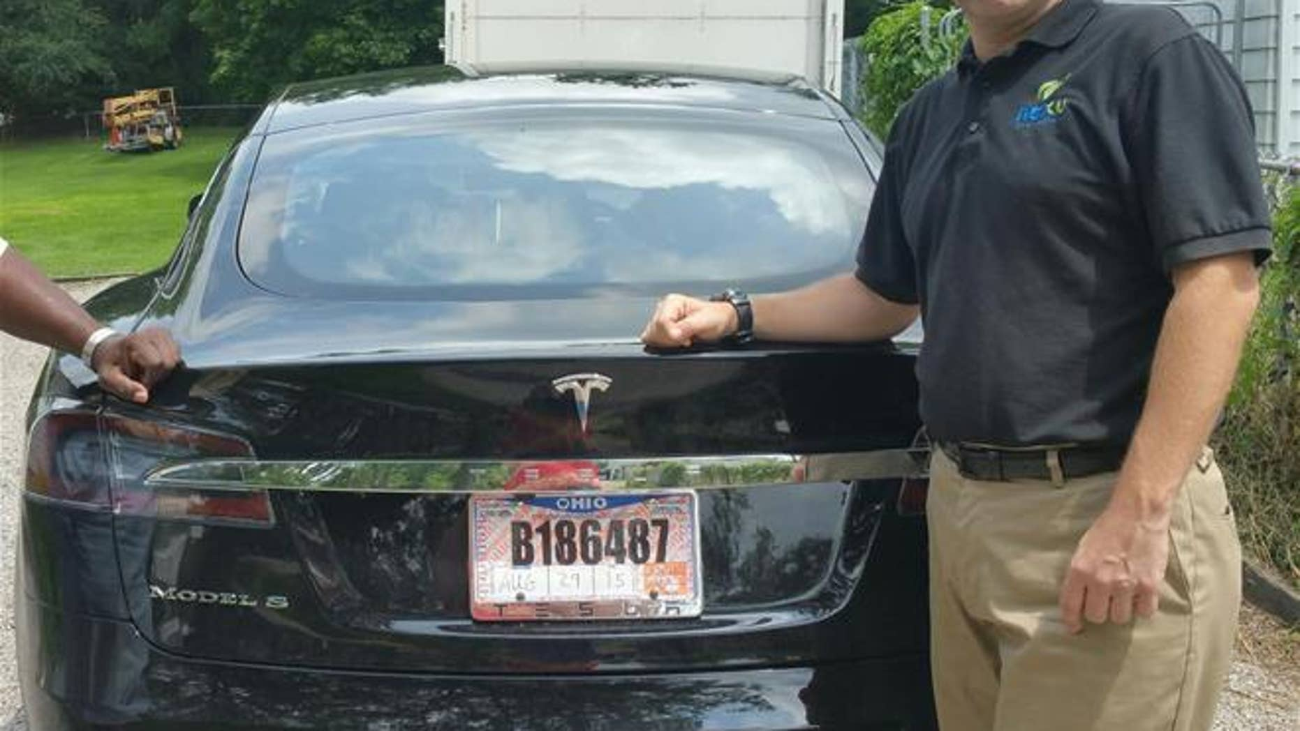 Joshua Brown stands by his new Tesla in 2015. Last month, he was killed while the car was in autopilot.