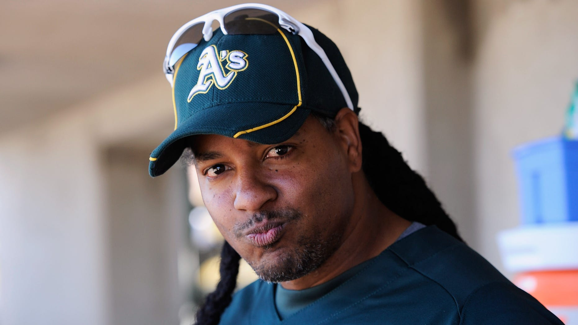 PHOENIX, AZ - MARCH 10:  Manny Ramirez #1 of the Oakland Athletics before the start of a spring training baseball game against the Cincinnati Reds at the Phoenix Municipal Stadium on March 10, 2012 in Phoenix, Arizona.  (Photo by Kevork Djansezian/Getty Images)