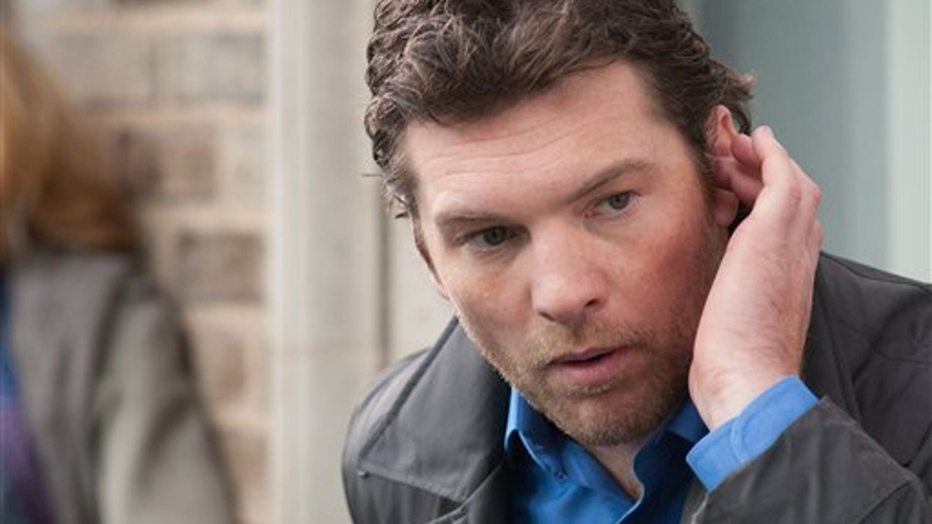 """In this film image released by Summit Entertainment, Sam Worthington is shown in a scene from """"Man on a Ledge."""" (AP Photo/Summit Entertainment, Myles Aronowitz)"""