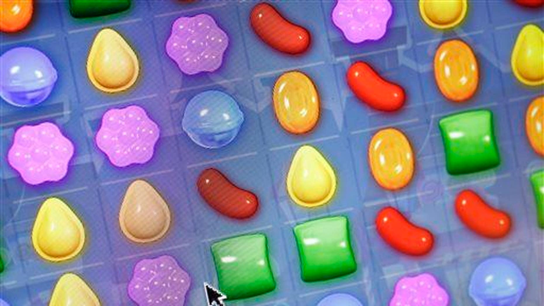 "In this March 24, 2014, file photo, a detail from King Digital Entertainment's online game ""Candy Crush Saga"" is shown."