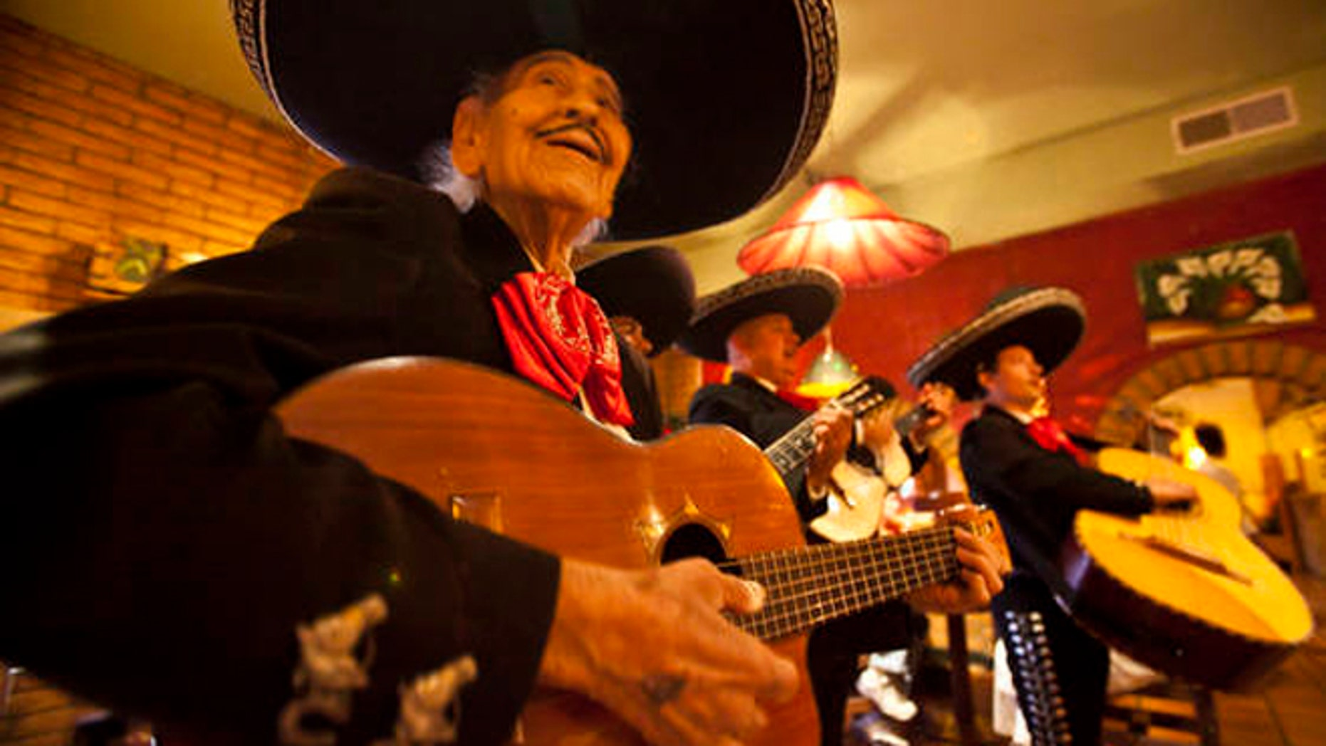 April 13: Singer Manuel Gonzalez, 91, performs with the mariachi band Del Monte at Rio Mirage Cafe and Cantina in El Mirage, Ariz. (AP Photo/The Arizona Republic, Michel Duarte)