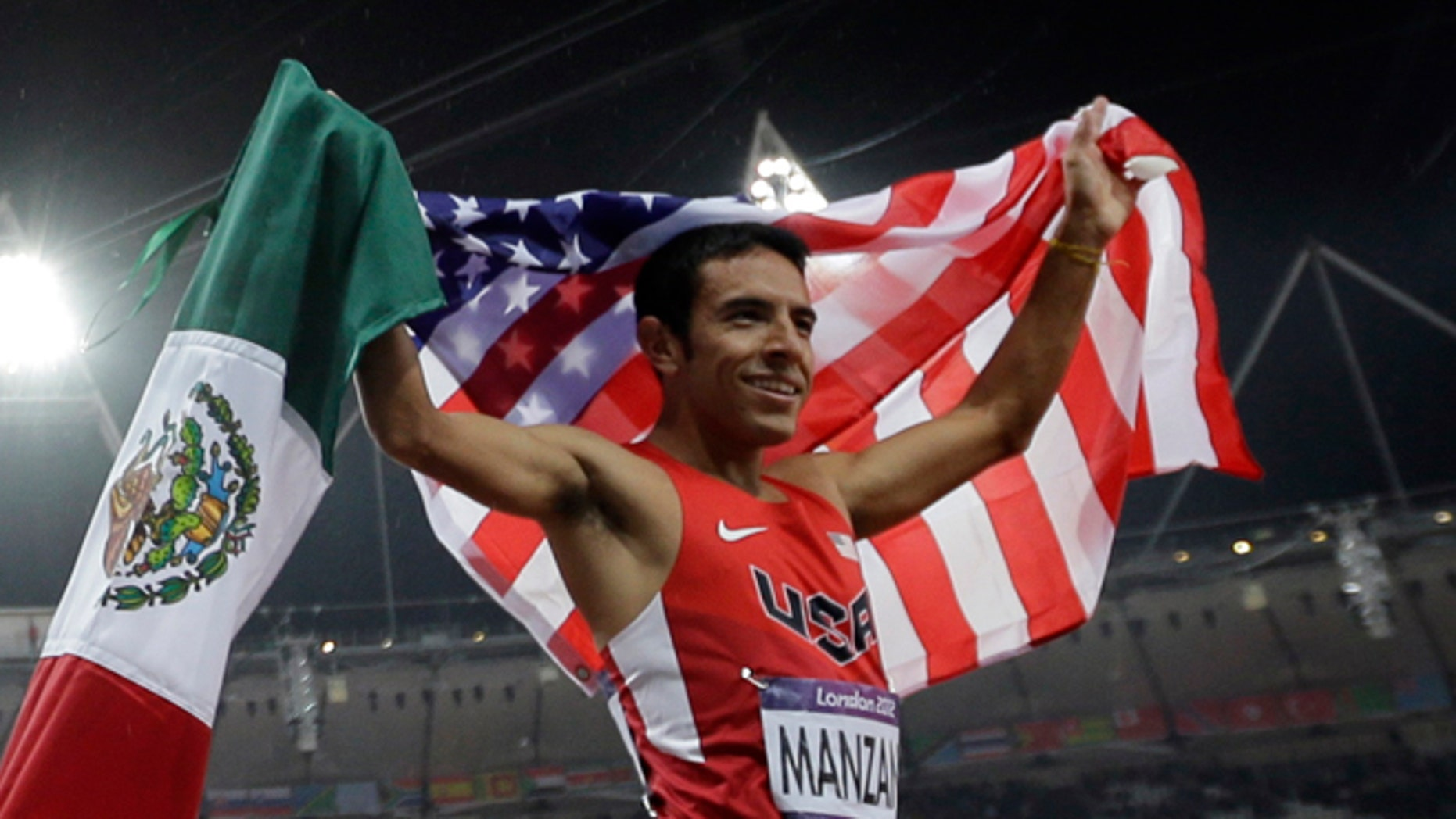 Gold medalist Taoufik Makhloufi of Algeria celebrates with silver medalist USA's Leonel Manzano after the men's 1500-meter during the athletics in the Olympic Stadium at the 2012 Summer Olympics, London, Tuesday, Aug. 7, 2012. (AP Photo/Matt Slocum)